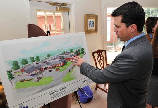 Hospice of Wichita Falls Director of Development Jake Truette shows an artist rendering of the new patient care center during a recent press conference announcing the groundbreaking for the construction new facility.