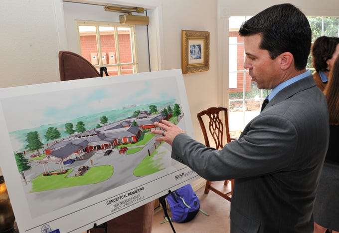 Hospice of Wichita Falls, director of development, Jake Truette shows an artist rendering of the new patient care center during a press conference announcing the groundbreaking for the construction new facility Tuesday morning.