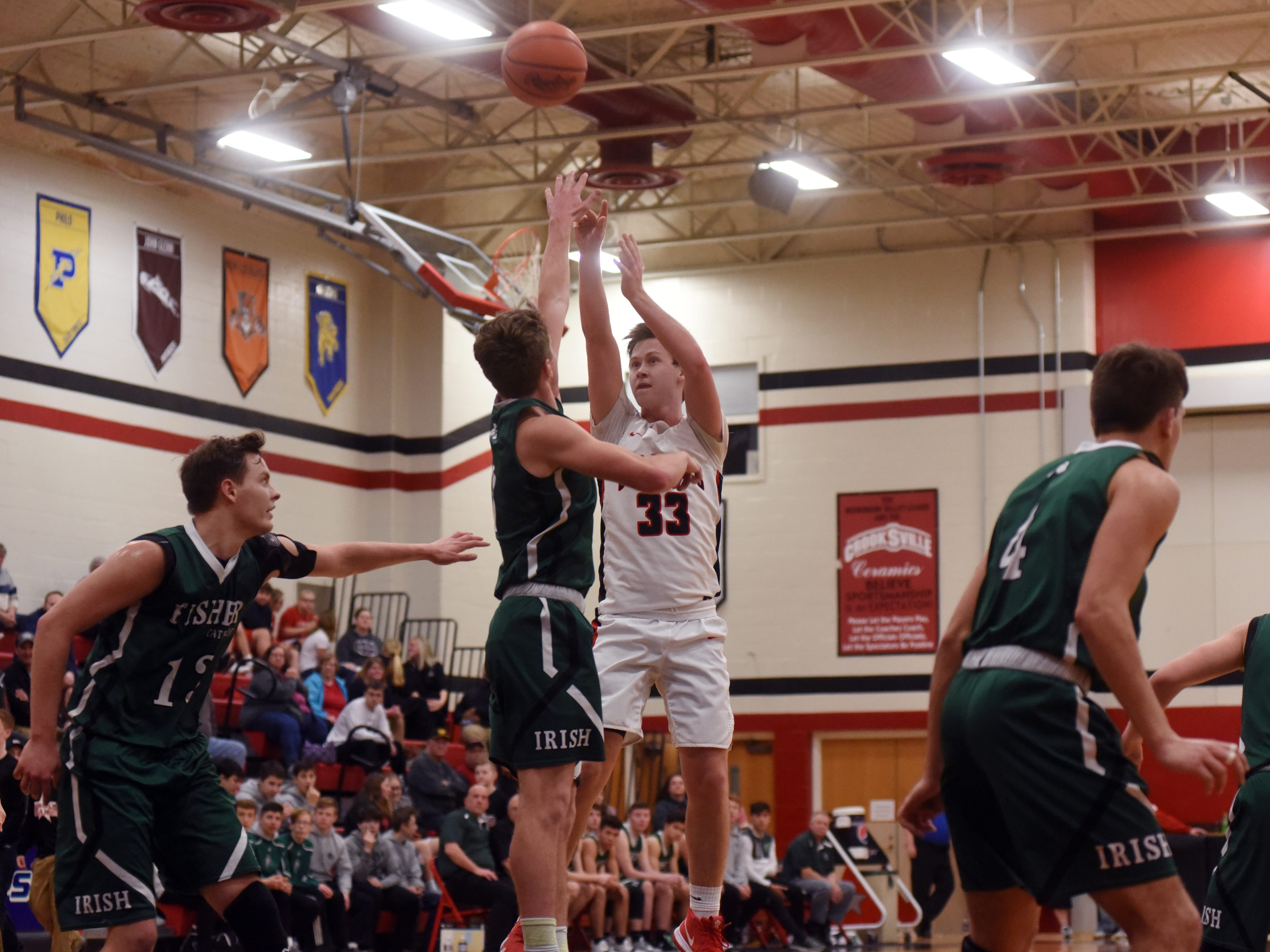 Brock White, of Crooksville, shoots a jumper against Fisher Catholic on Monday night in McLuney.