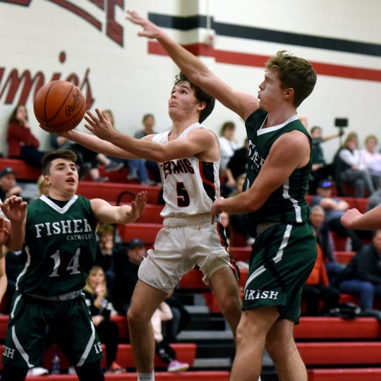 Crooksville's Colt White goes in for a layup against Fisher Catholic on Monday night in McLuney.