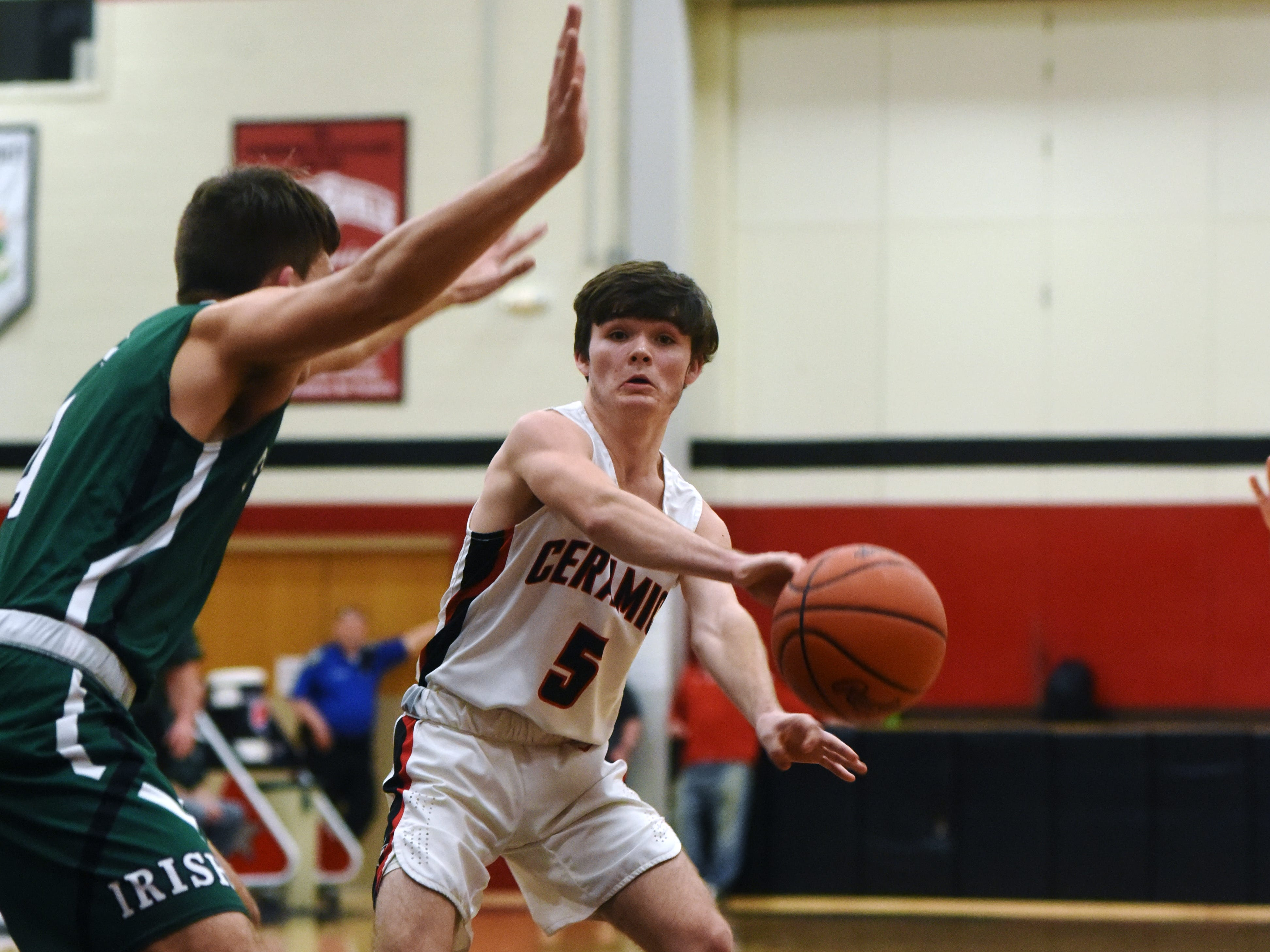 Colt White, of Crooksville, passes to a eammate against Fisher Catholic on Monday night in McLuney.