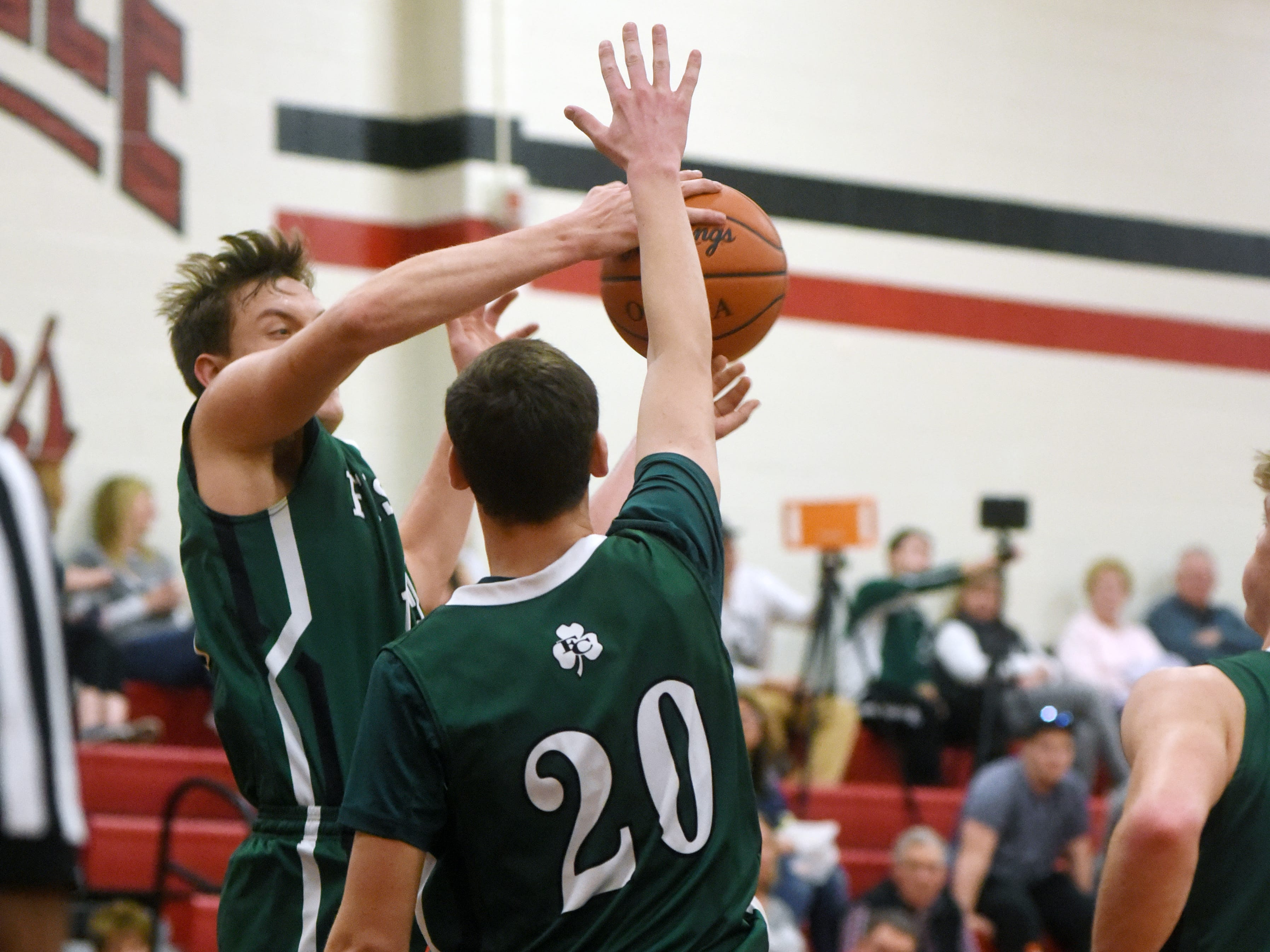 Daniel Turner, of Fisher Catholic, blocks a shot against Crooksville on Monday night in McLuney.