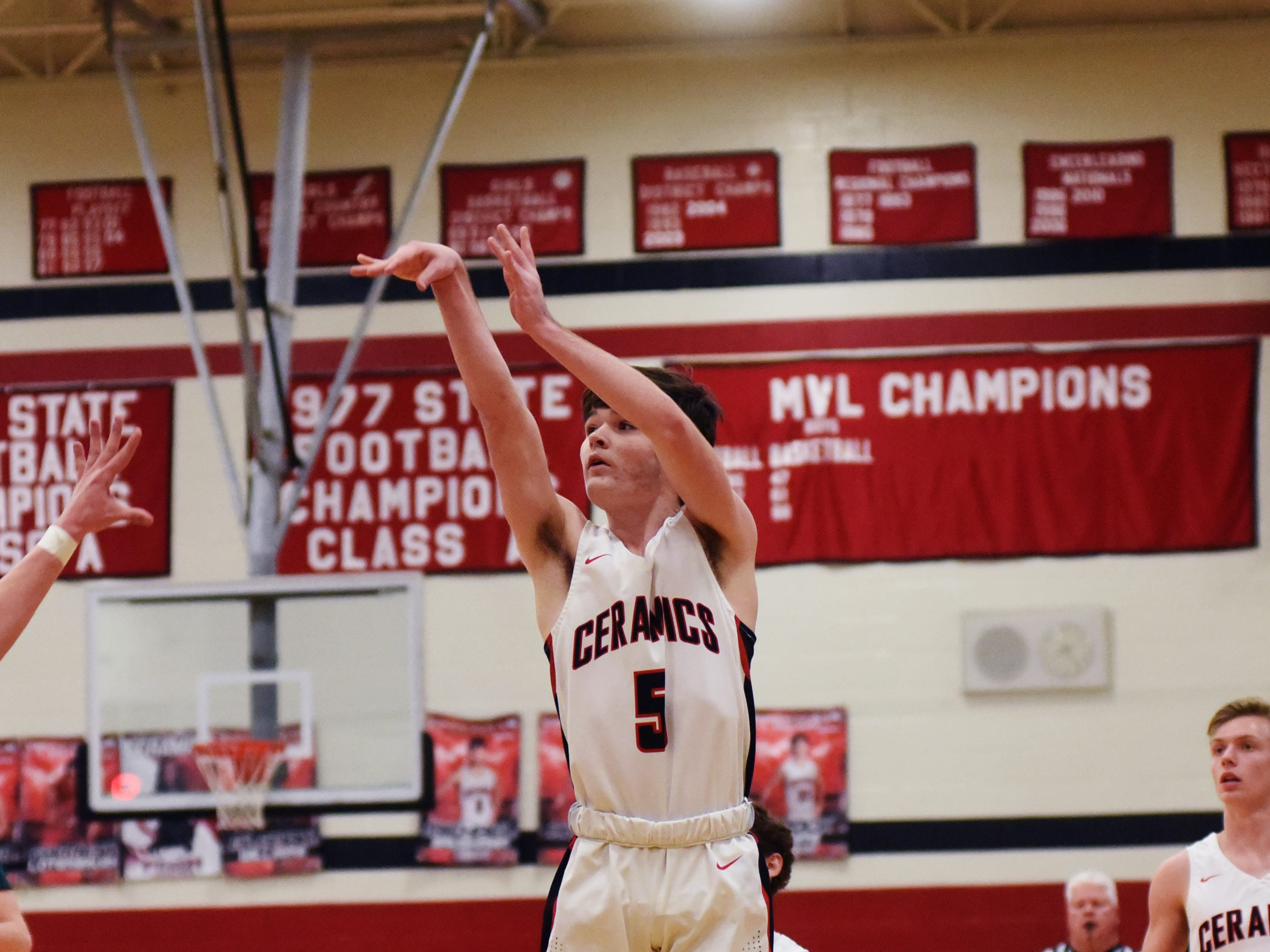 Colt White, of Crooksville, shoots a 3 against Fisher Catholic on Monday night in McLuney.