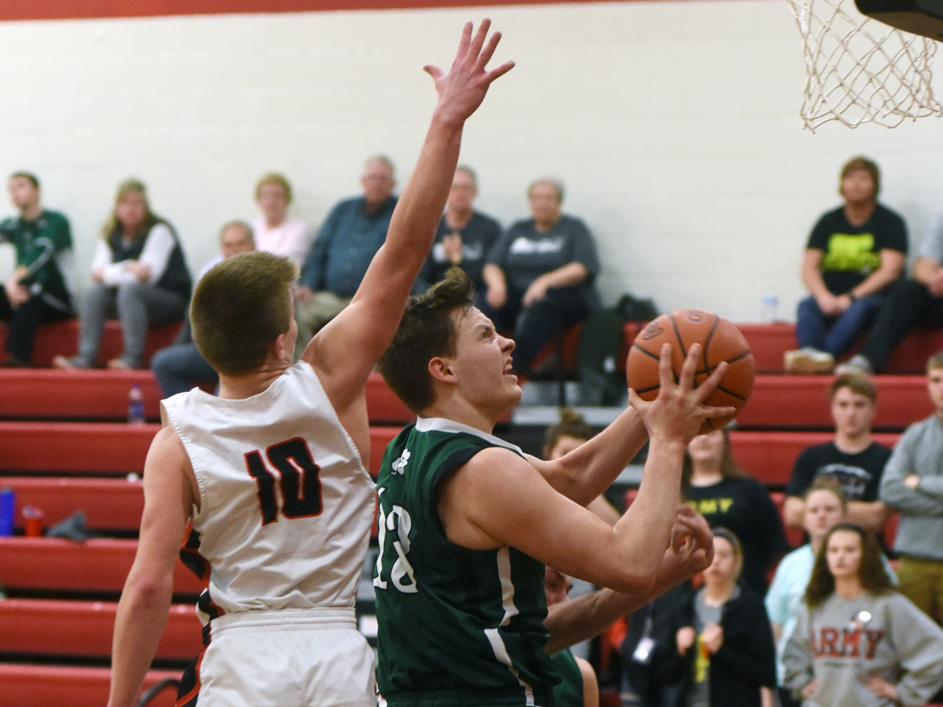 Bailey Francis, of Fisher Catholic, goes up in traffic against Crooksville on Monday night in McLuney.