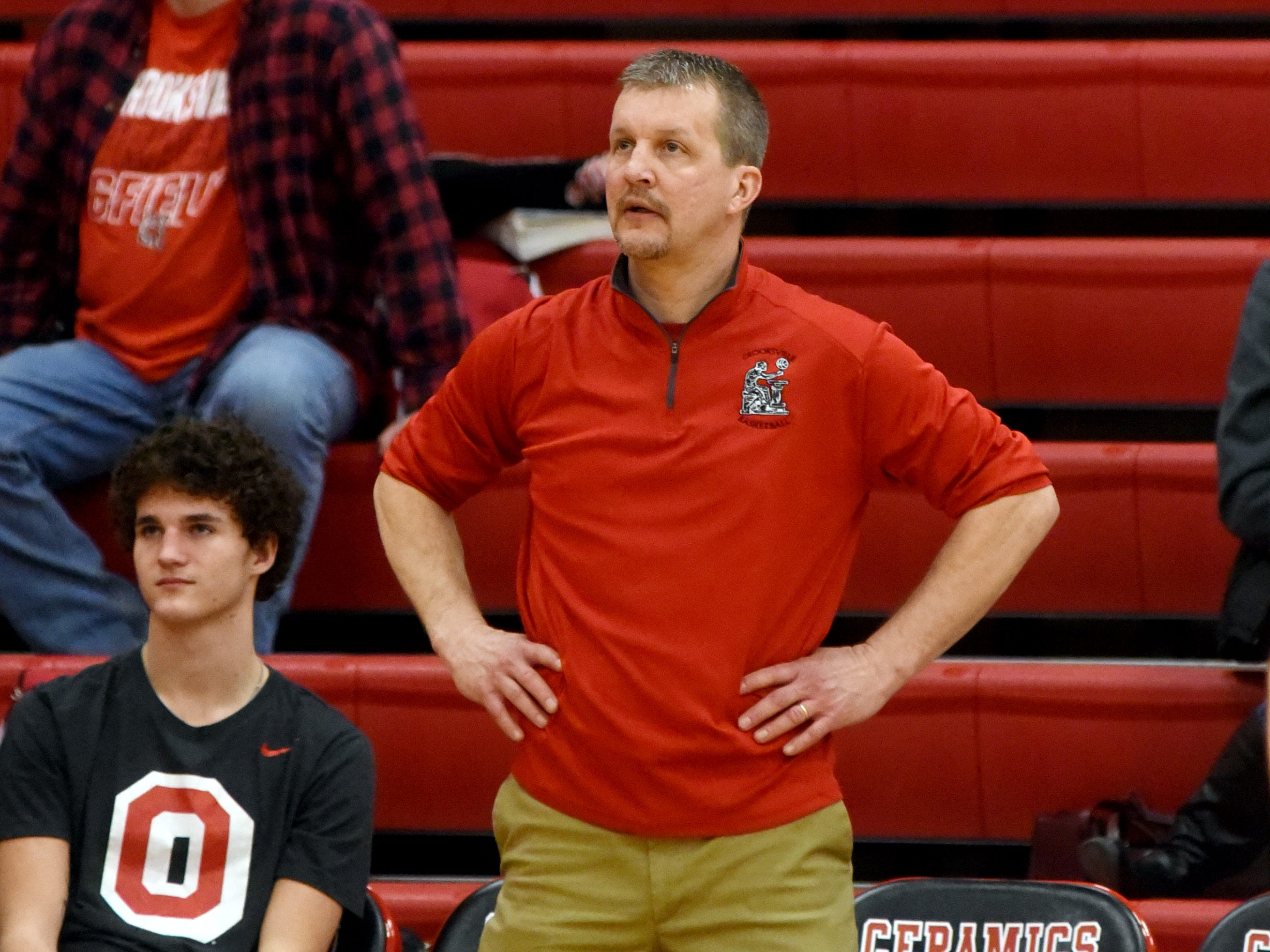 Crooksville coach Travis German watches the action against Fisher Catholic on Monday night in McLuney.