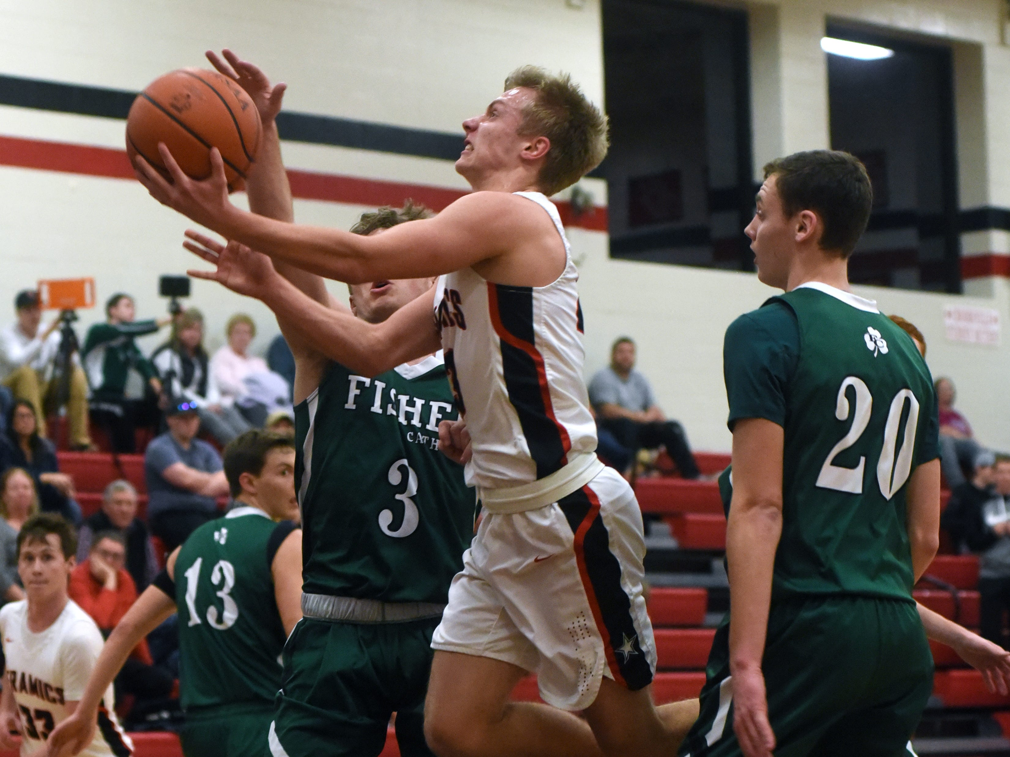 Caden Sparks goes in for a layup against Fisher Catholic on Monday night in McLuney.