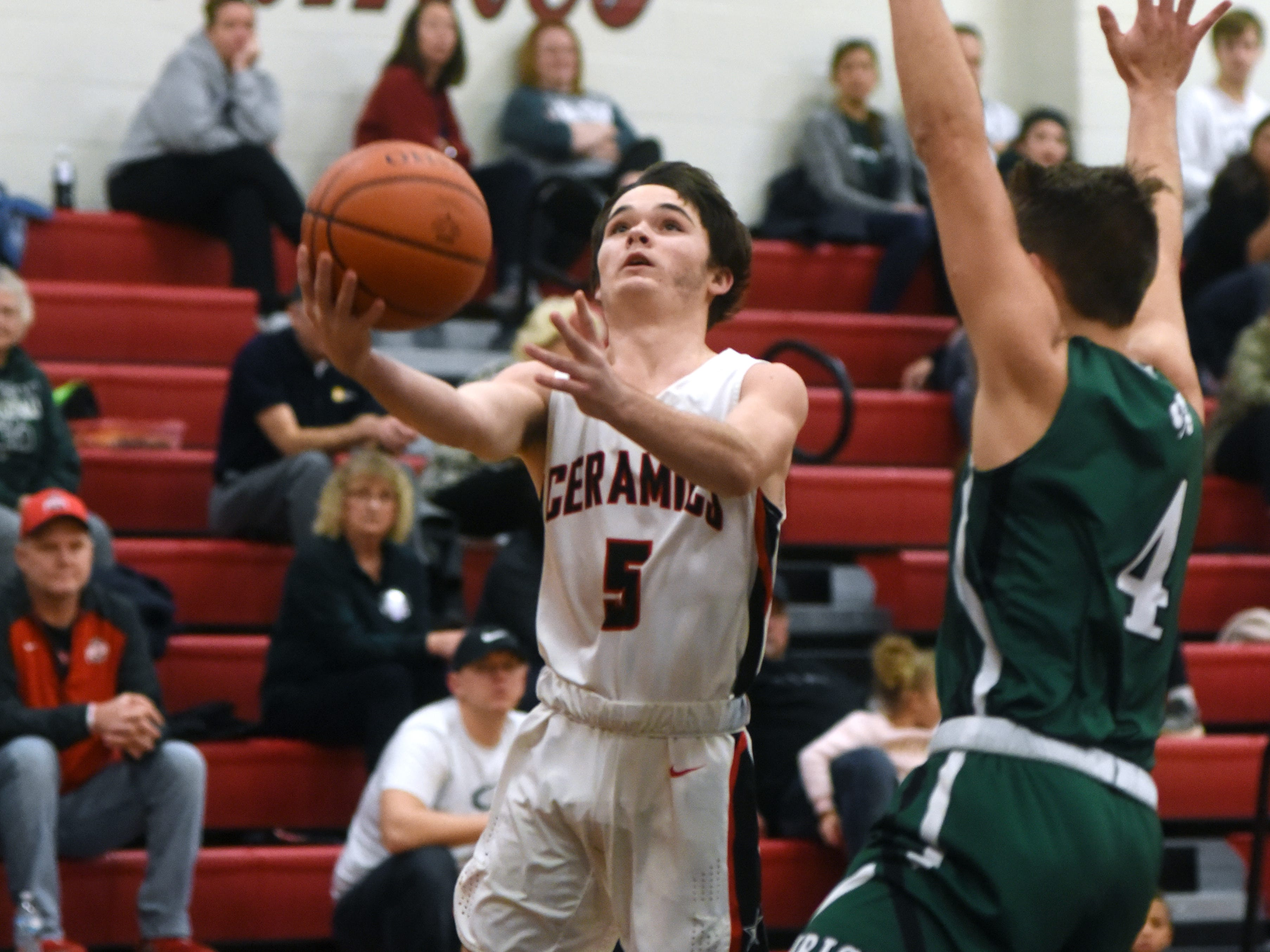 Crooksville's Colt White goes up for a layup against against Fisher Catholic on Monday night in McLuney.