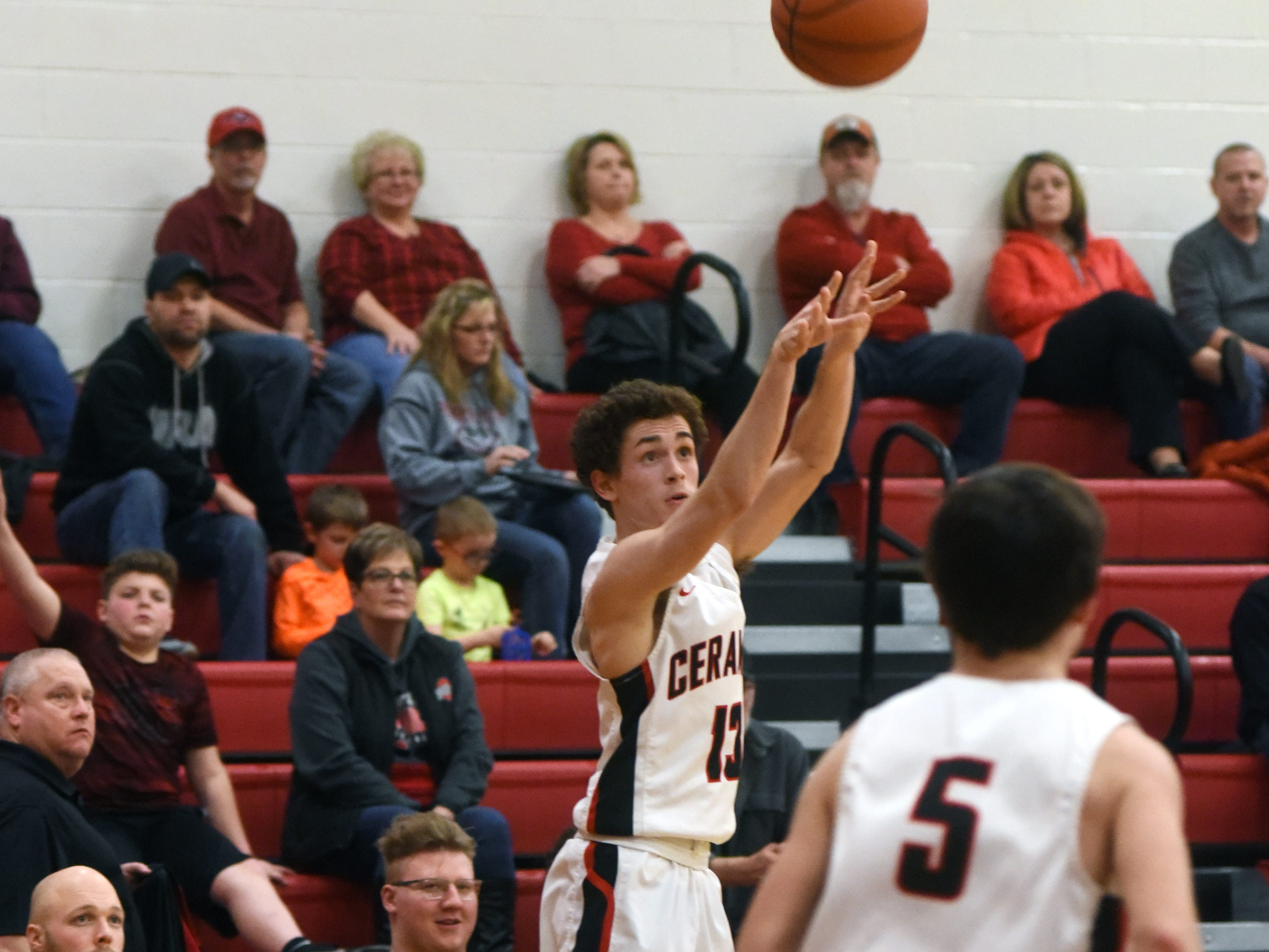 Crooksville's Tyler Rambo shoots a 3 against Fisher Catholic on Monday night in McLuney.