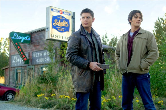 Dean (Jensen Ackles, left) and Sam (Jared Padalecki) have frequented many hole-in-the-wall bars on their epic road trip.