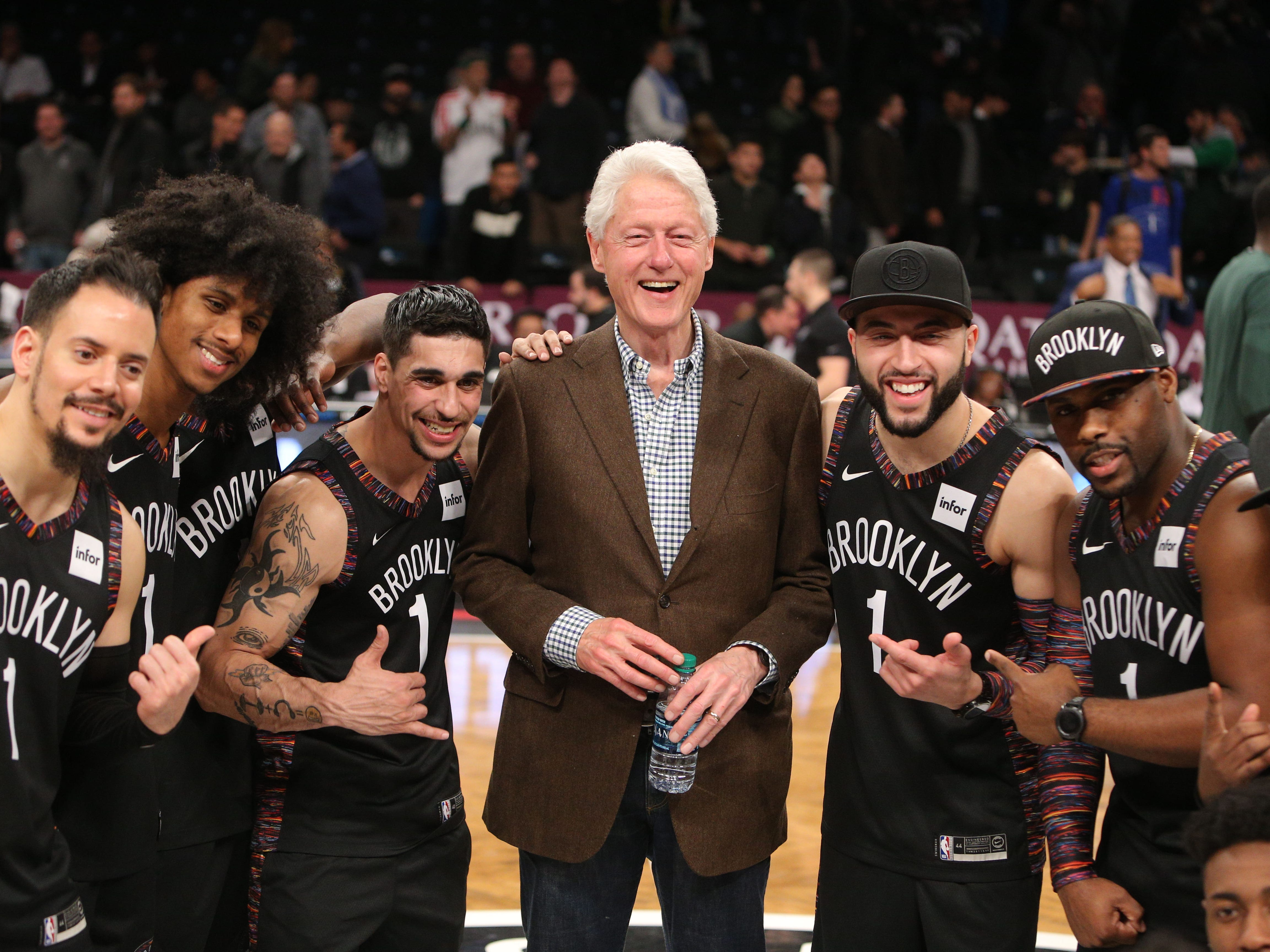 Feb. 4: Former U.S. President Bill Clinton poses for a photo with the Brooklyn Nets hype crew after a game against the Milwaukee Bucks at Barclays Center.