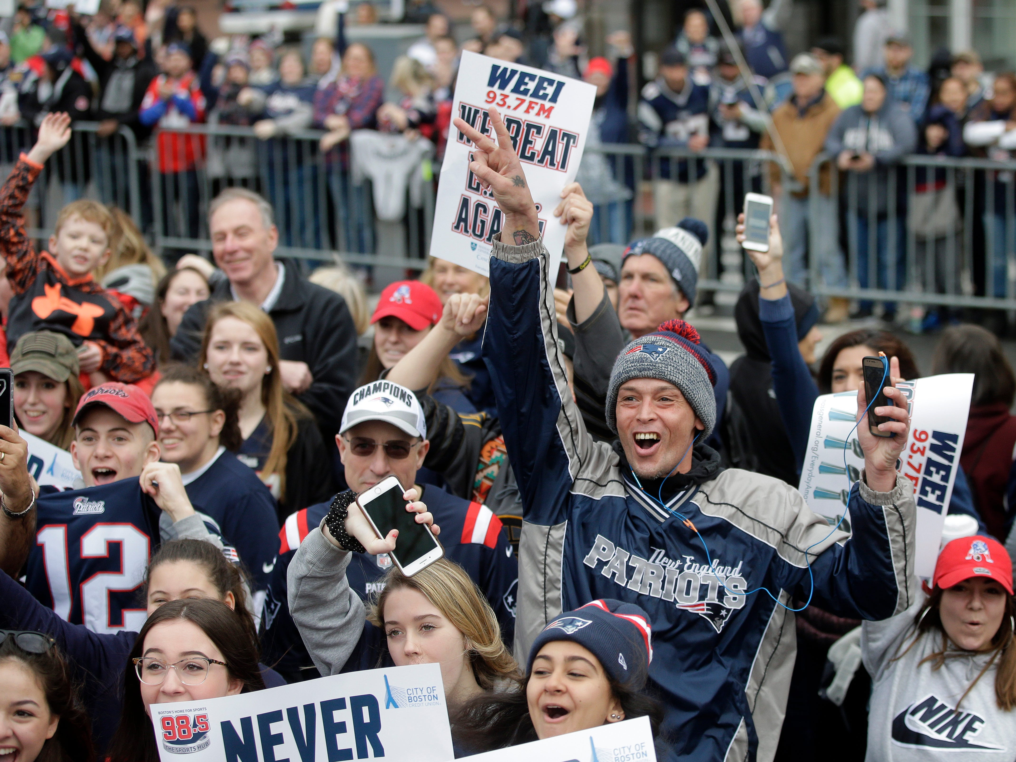 Fans wait for the New England Patriots parade to through downtown Boston to celebrate their win over the Los Angeles Rams in Sunday's NFL Super Bowl 53 football game in Atlanta. (AP Photo/Steven Senne)