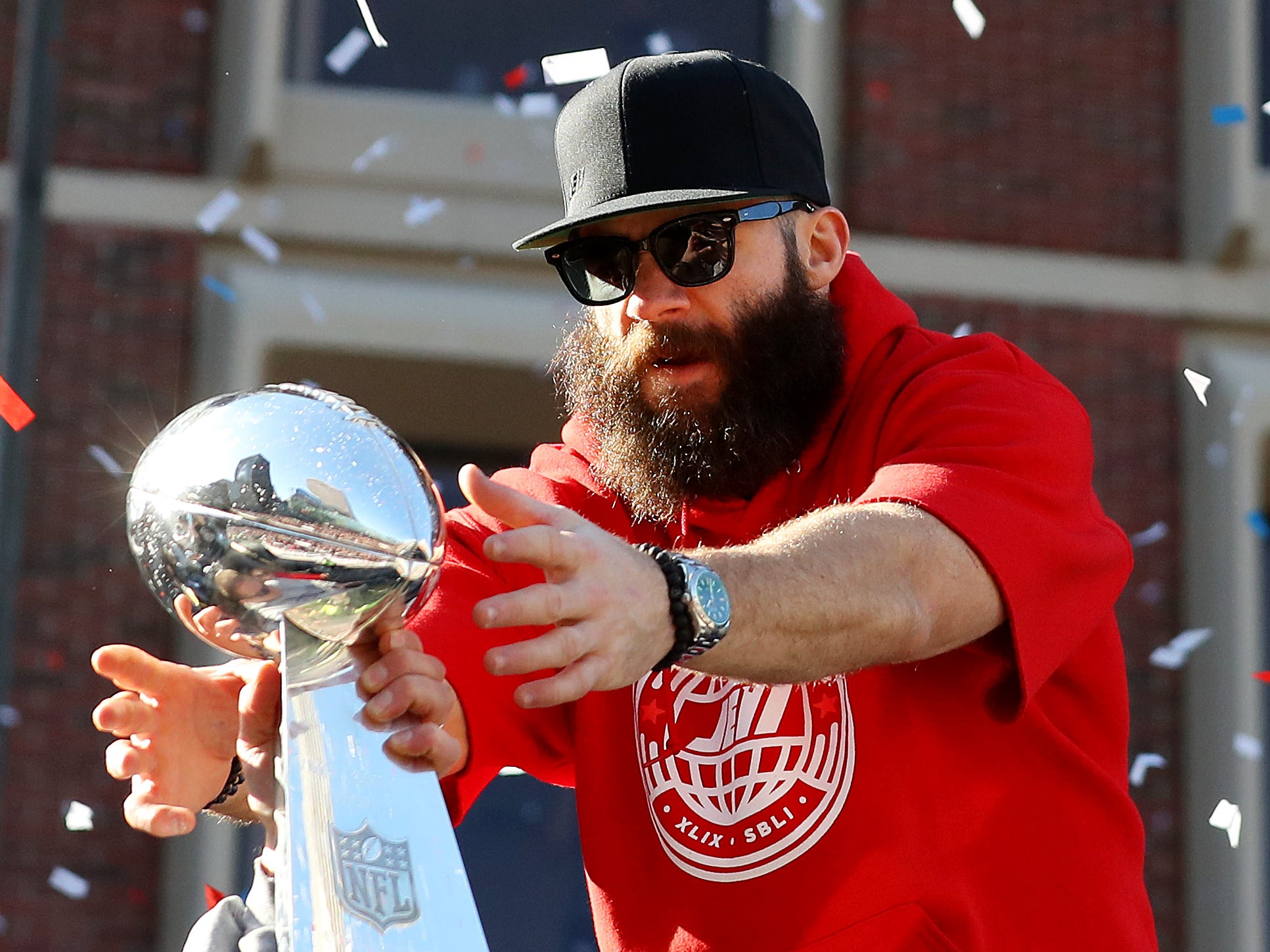 Julian Edelman of the New England Patriots celebrates with the Lombardi Trophy on Cambridge street during the New England Patriots Victory Parade on February 05, 2019 in Boston, Massachusetts.