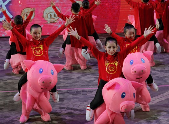 Performers take part in a night parade to celebrate Chinese New Year in Hong Kong on Feb. 5, 2019. The Lunar New Year this year marks the Year of the Pig in the Chinese calendar.