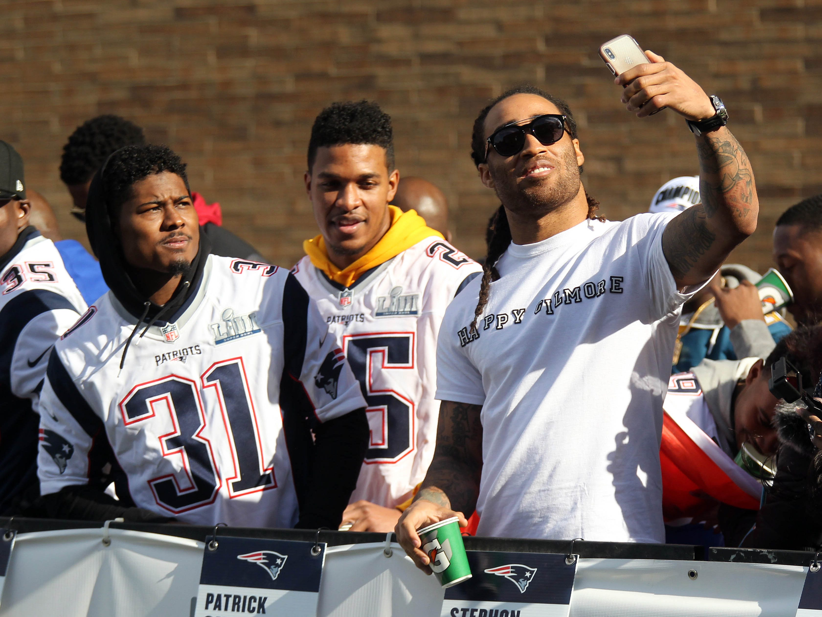 New England Patriots cornerback Stephon Gilmore , right, poses for a photo with cornerback Jonathan Jones (31) prior to the start of the Super Bowl LIII championship parade.