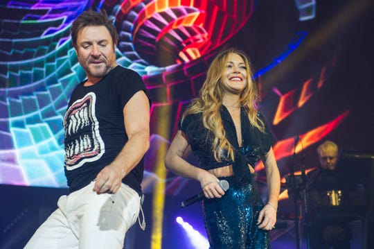 Simon Le Bon of Duran Duran and special guest Lindsay Lohan perform at The O2 Arena on December 8, 2015 in London, England.