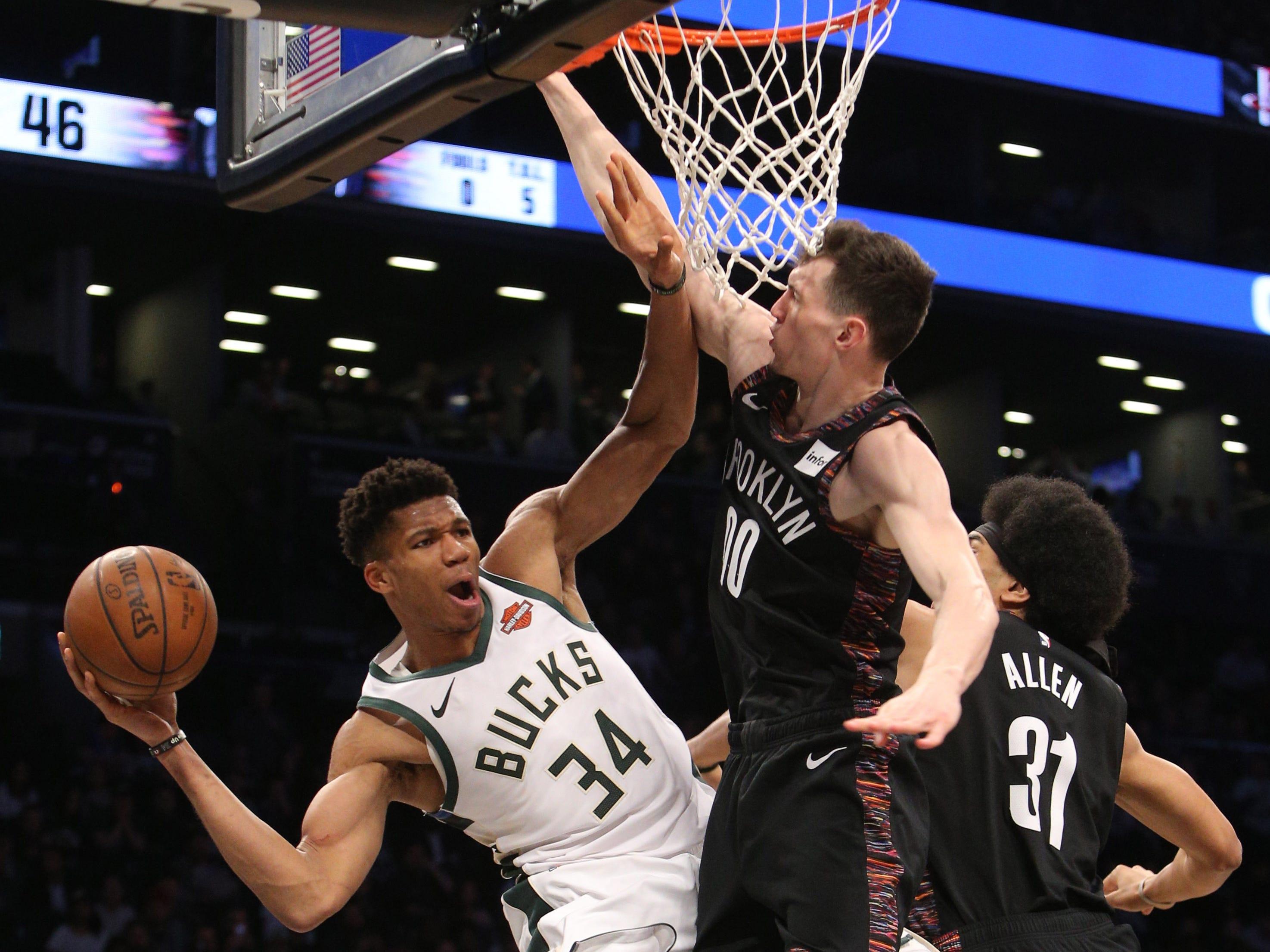 Feb. 4: Giannis Antetokounmpo passes around Brooklyn Nets small forward Rodions Kurucs (00) and center Jarrett Allen (31) during the third quarter of the Milwaukee Bucks' 113-94 win at Barclays Center.