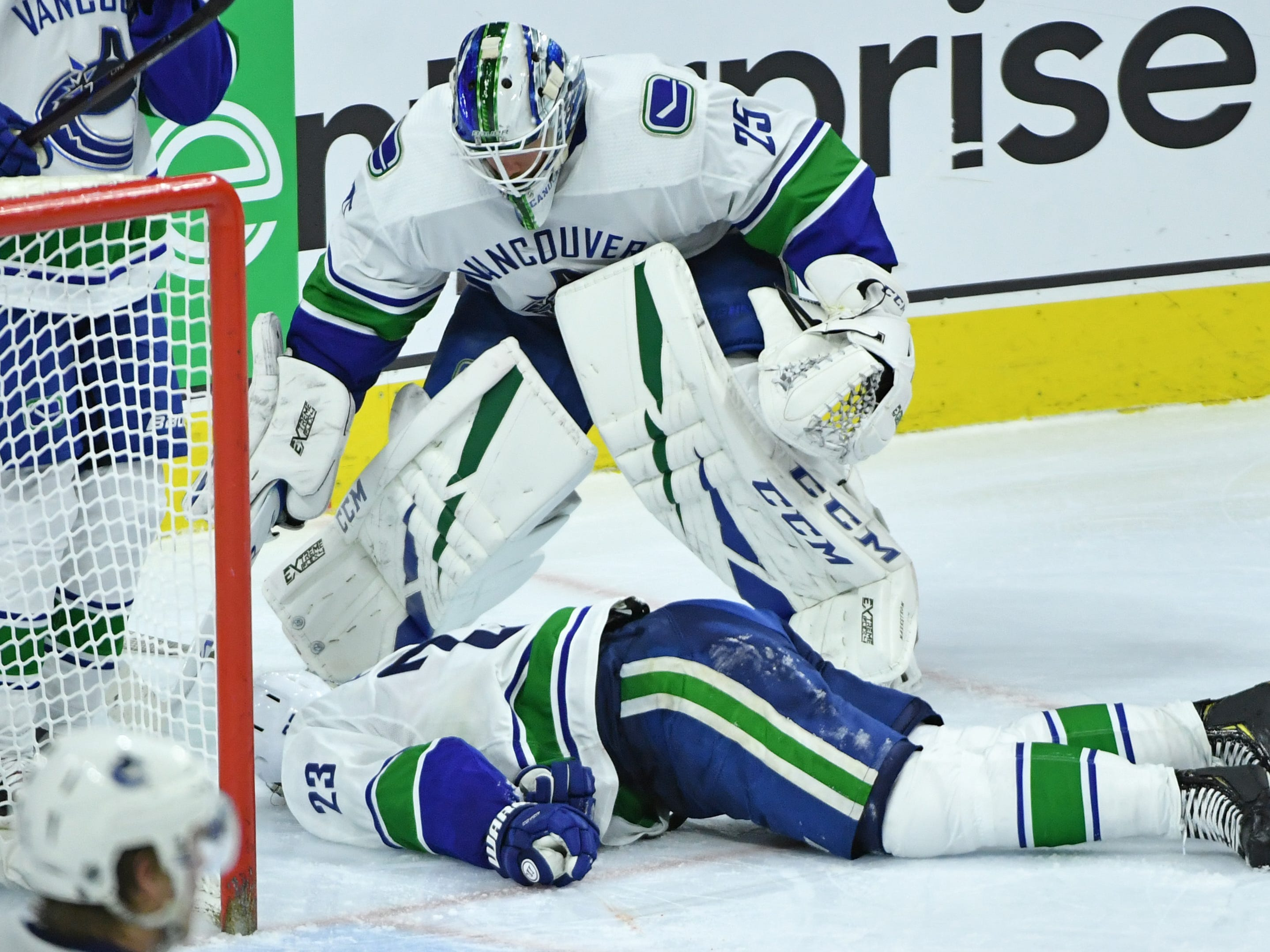 Feb. 4: Vancouver Canucks goaltender Jacob Markstrom tries to help defenseman Alex Edler after he was injured against the Philadelphia Flyers during the third period at Wells Fargo Center.