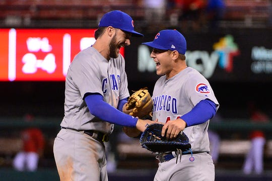 In this 2017 file photo, Chicago Cubs first baseman Anthony Rizzo (44) third baseman Kris Bryant (17) after the Cubs defeated the St. Louis Cardinals and clinched the NL Central Division at Busch Stadium.