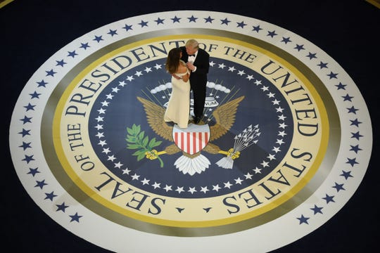 President Donald Trump and first lady Melania dance at the Armed Services ball at the National Building museum in Washington, D.C., on Jan. 20, 2017.
