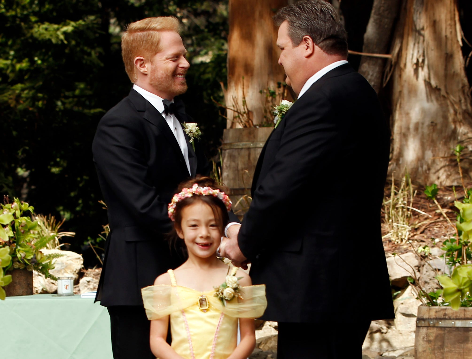 Aubrey Anderson-Emmons, Jesse Tyler Ferguson and Eric Stonestreet in season five, in which Mitch and Cam got married with their daughter, Lily, serving as flower girl.