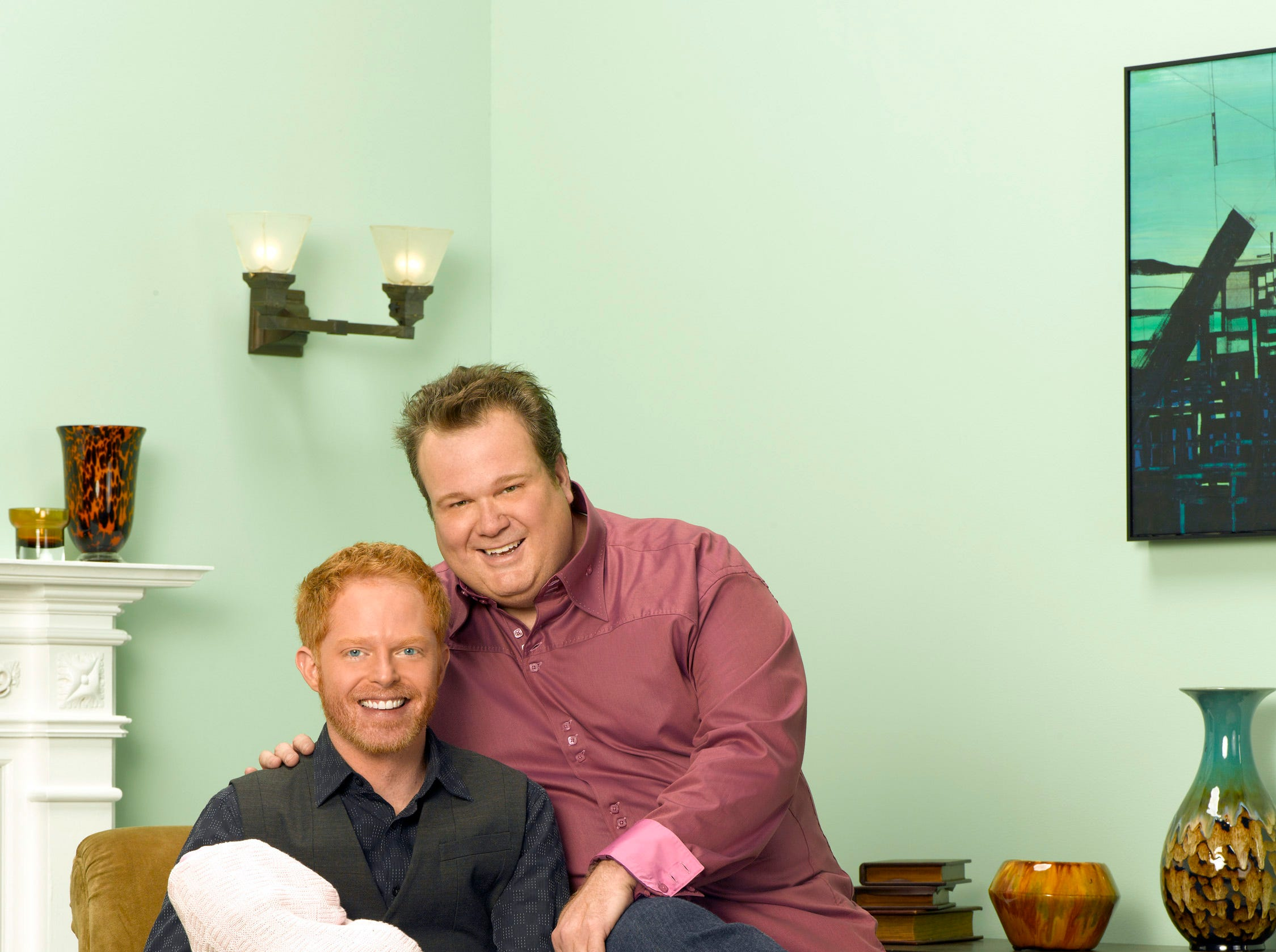 Jesse Tyler Ferguson as Mitchell and Eric Stonestreet as Cameron in the first season.