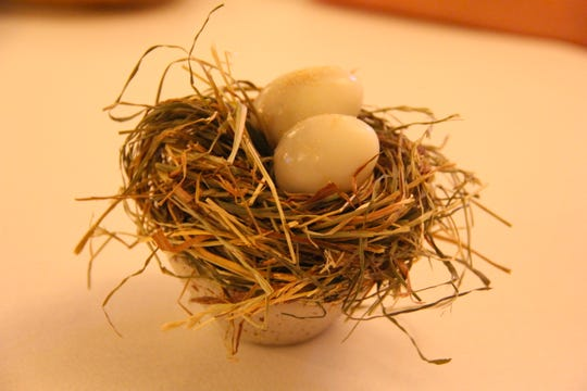 At Dragsholm Gourmet, soft-boiled quail eggs arrive in a makeshift nest, dusted lightly with a umami-salt coating.