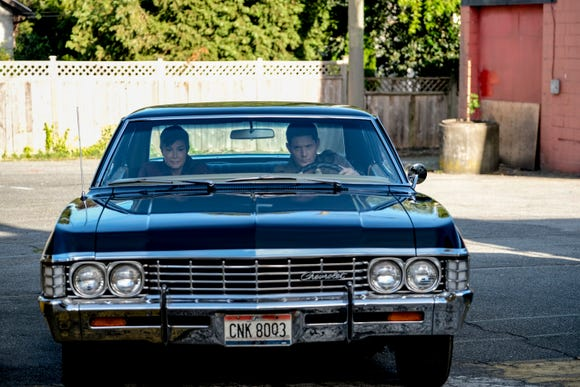 Dean (Jensen Ackles, right) and fequent ally Sheriff Jody Mills (Kim Rhodes) get ready to ride in the Winchesters' signature black Impala.