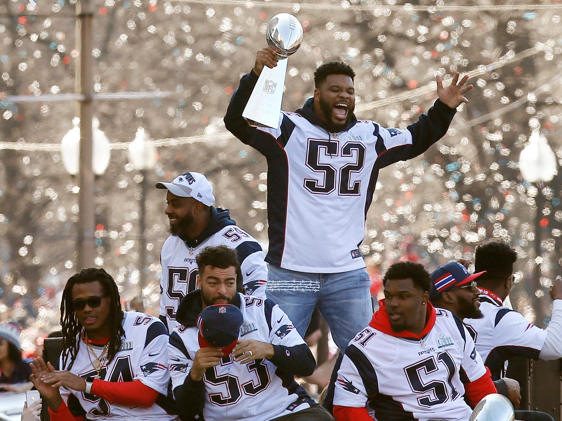 New England Patriots linebacker Elandon Roberts (52) rides a duck boat during the Patriots parade through downtown Boston, Tuesday, Feb. 5, 2019, to celebrate their win over the Los Angeles Rams in Sunday's Super Bowl LIII game in Atlanta.