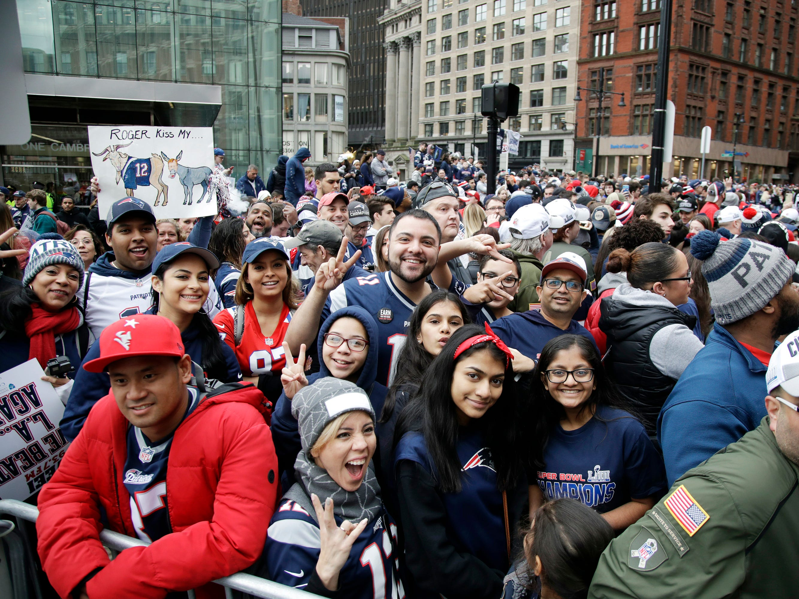 Fans gather near Boston City Hall to watch the New England Patriots football team victory parade through the streets of Boston to celebrate their win over the Los Angeles Rams for their sixth NFL Super Bowl championship. (AP Photo/Elise Amendola)