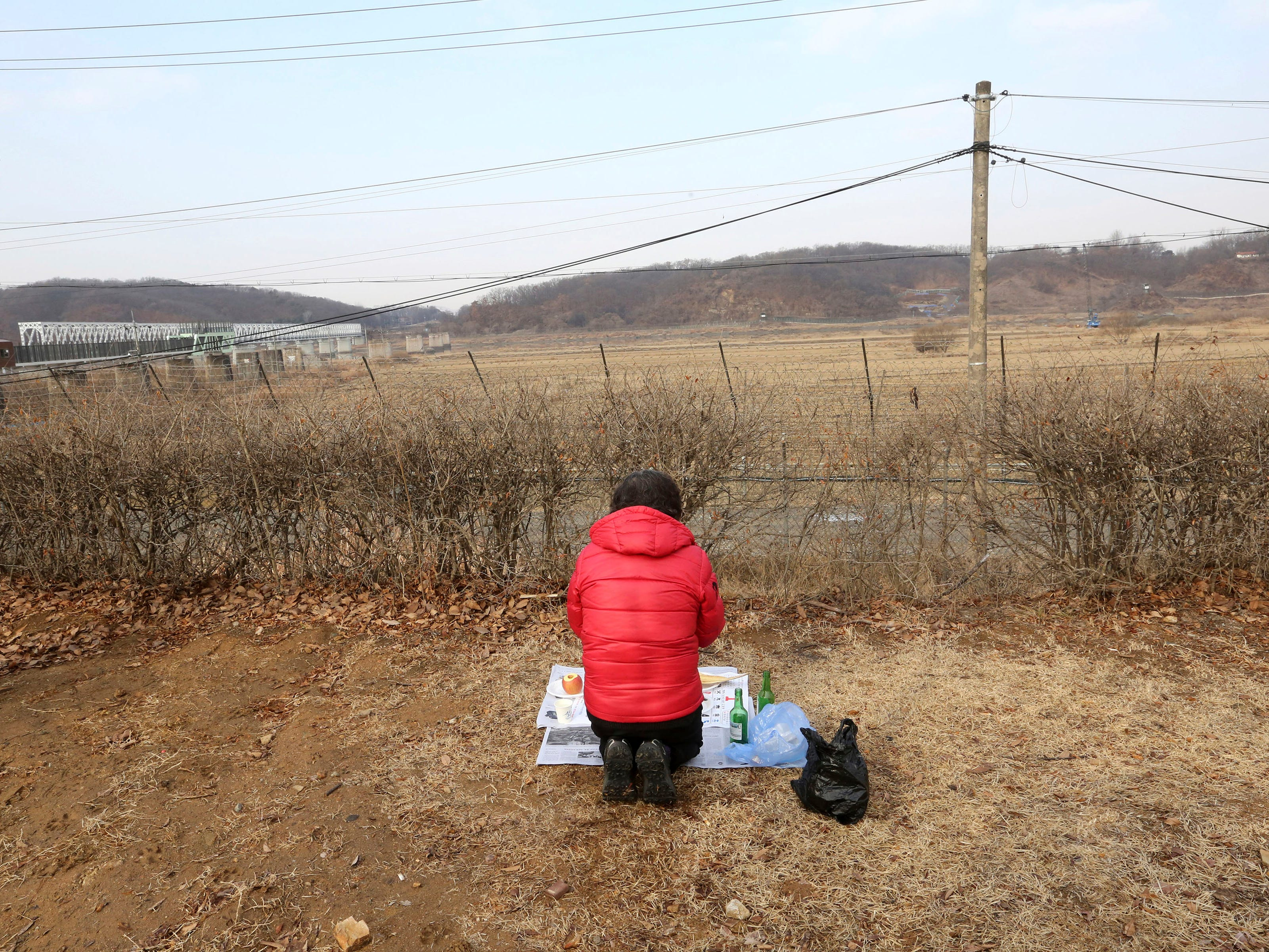 A North Korean refugee woman prays for her ancestors in North Korea as she visits the border to celebrate the Lunar New Year at the Imjingak Pavilion, near the demilitarized zone of Panmunjom, in Paju, South Korea, Tuesday, Feb. 5, 2019. (AP Photo/Ahn Young-joon) ORG XMIT: SEL104