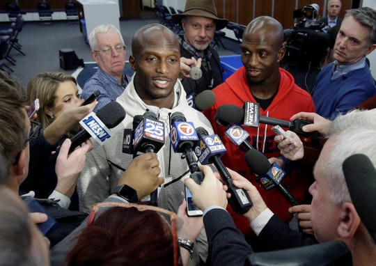 Patriots cornerback Jason McCourty, left, and his brother, free safety Devin McCourty, right, face reporters in the team's locker room following the team's arrival at Gillette Stadium on Monday after the Super Bowl victory.