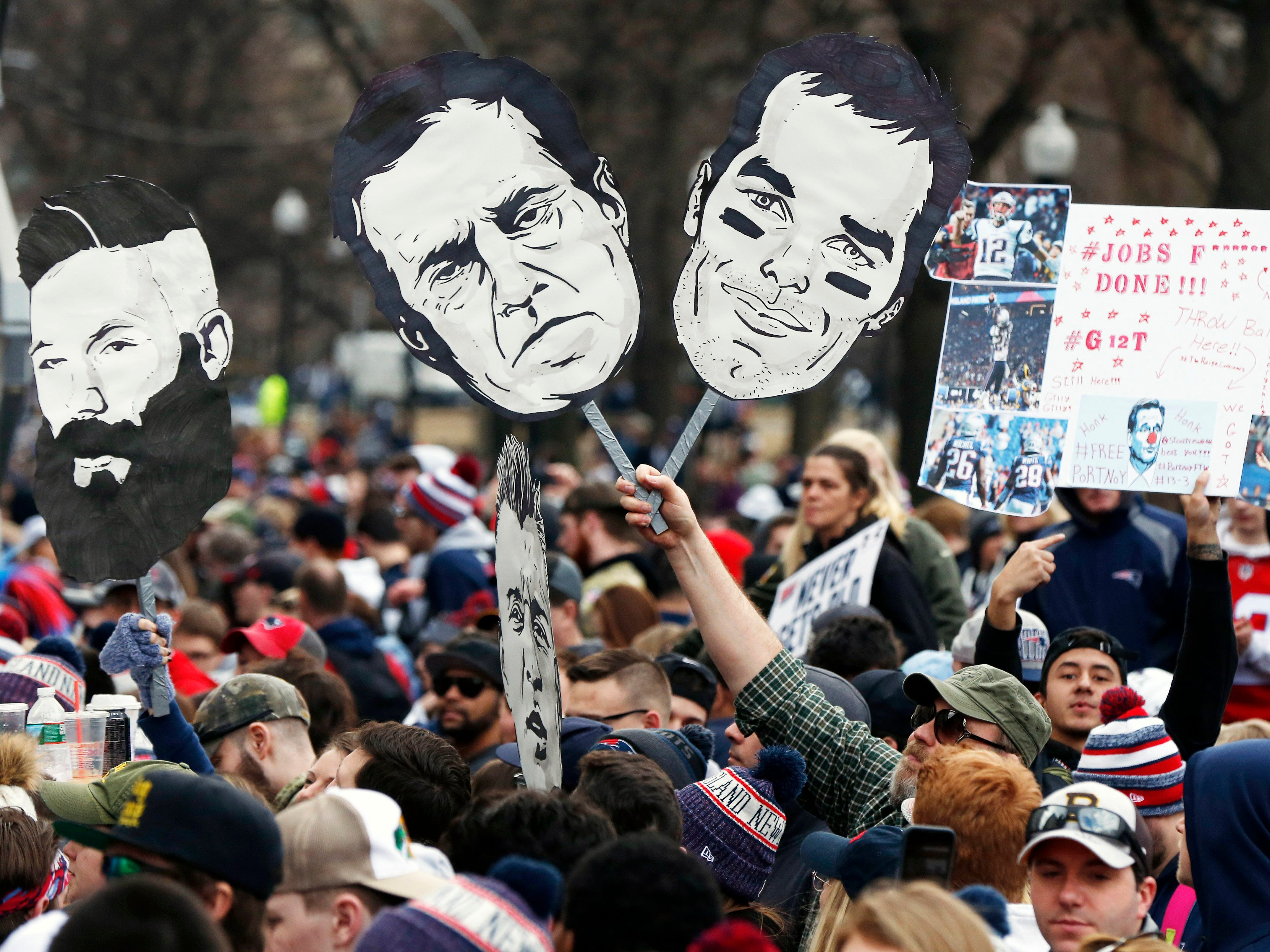 Fans gather to watch the New England Patriots parade to celebrate their win over the Los Angeles Rams in Sunday's NFL Super Bowl 53 football game in Atlanta. (AP Photo/Michael Dwyer)