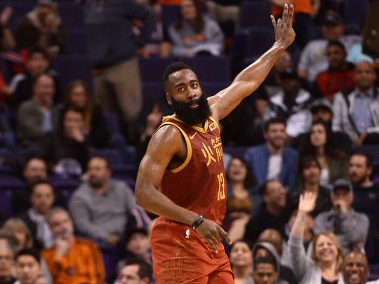 f21fbb23fcfb Houston Rockets guard James Harden (13) reacts against the Phoenix Suns.