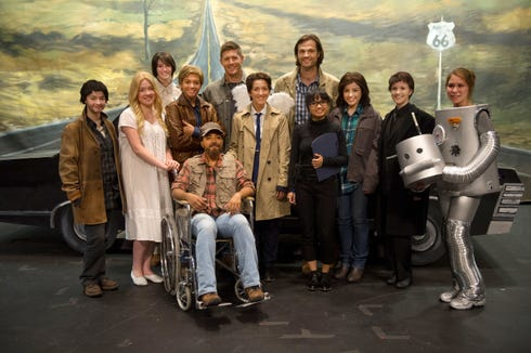 """""""Supernatural"""" Season 10 featured the Winchesters (Jensen Ackles and Jared Padalecki, in back) happening upon a high school musical production of their escapades."""
