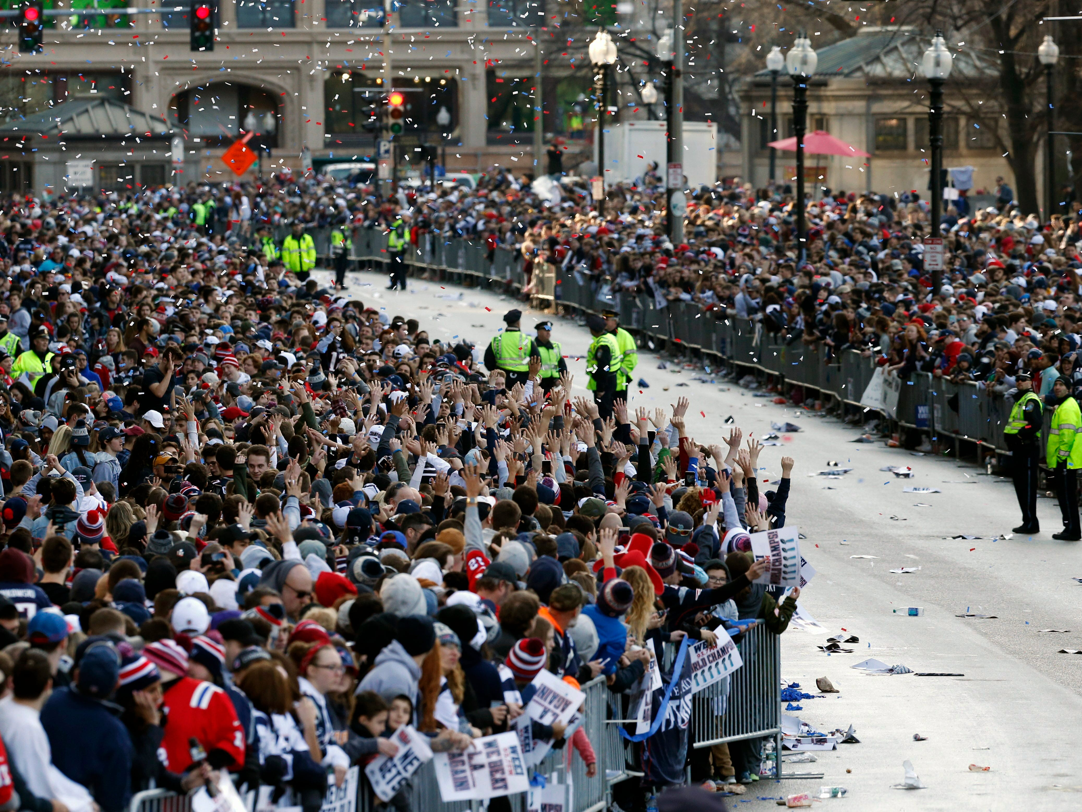 Fans line Tremont Street before the New England Patriots parade through downtown Boston, Tuesday to celebrate their win over the Los Angeles Rams in Sunday's NFL Super Bowl 53 football game in Atlanta. (AP Photo/Michael Dwyer)