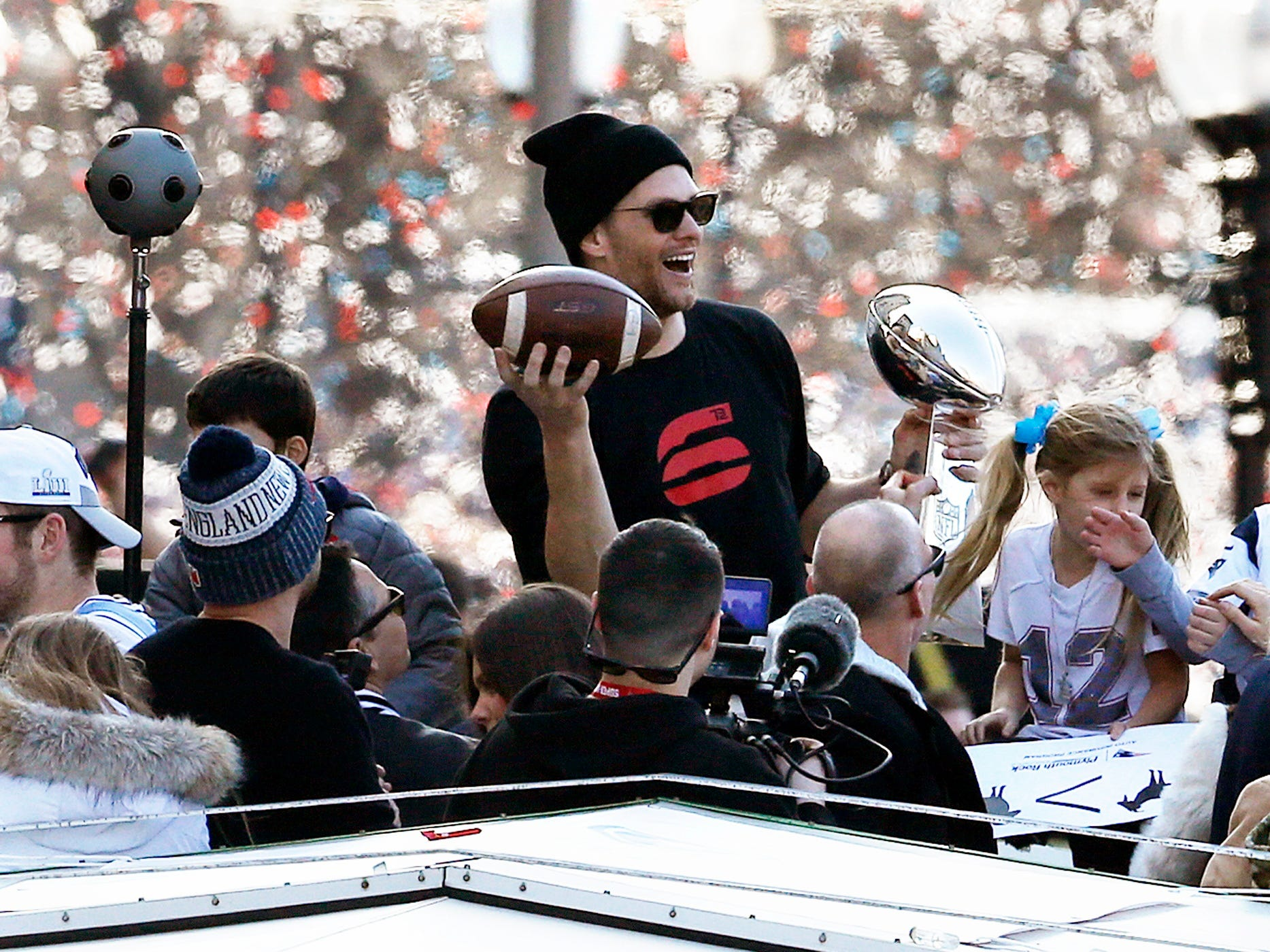 New England Patriots quarterback Tom Brady rides a duck boat during the Patriots parade through downtown Boston, Tuesday, Feb. 5, 2019, to celebrate their win over the Los Angeles Rams in Sunday's Super Bowl LIII in Atlanta.