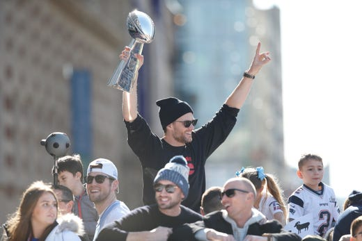 3aa85a019 New England Patriots quarterback Tom Brady (12) holds up the Vince Lombardi  Trophy during