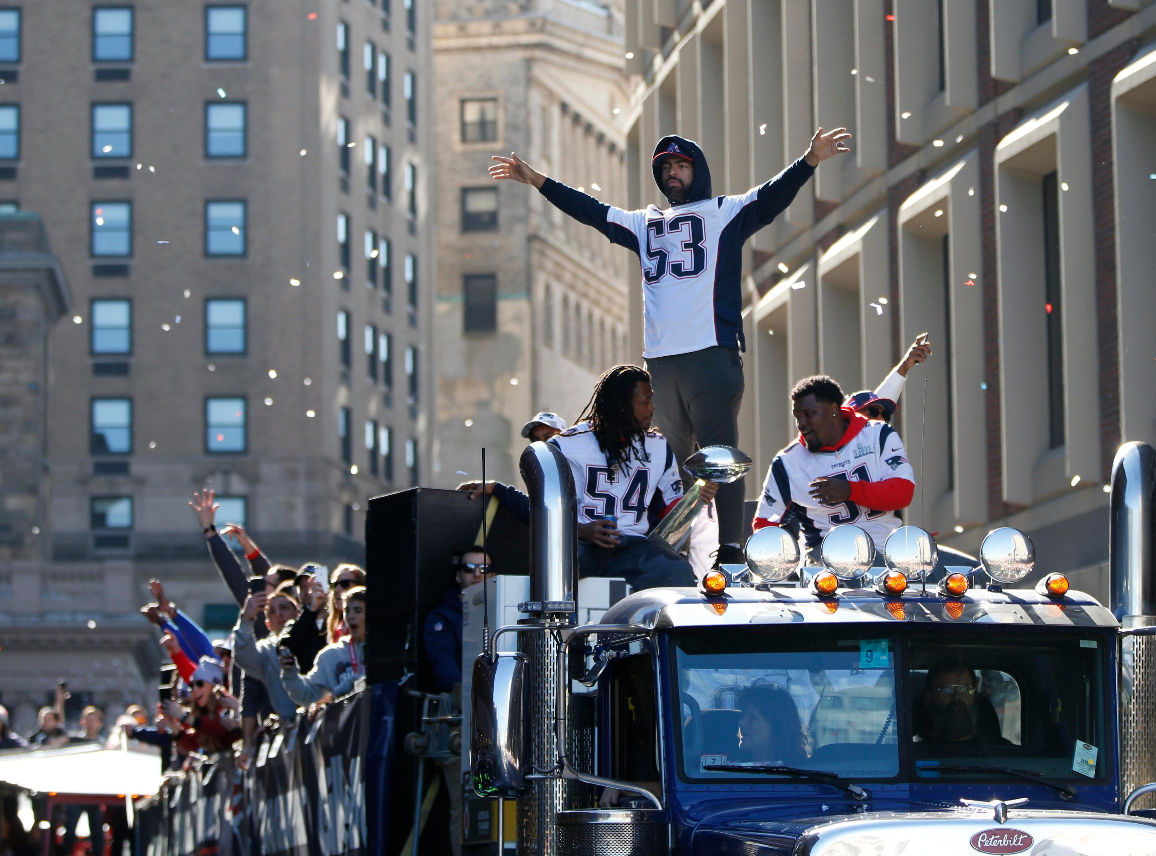 New England Patriots middle linebacker Kyle Van Noy (53) celebrates during the Super Bowl LIII championship parade through downtown Boston.