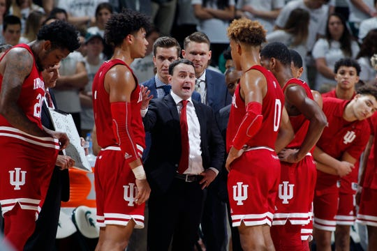 Indiana coach Archie MIller, center, talks to his players during a timeout against Michigan State in the first half of an NCAA college basketball game, Saturday, Feb. 2, 2019, in East Lansing, Mich. Indiana won 79-75 in overtime.
