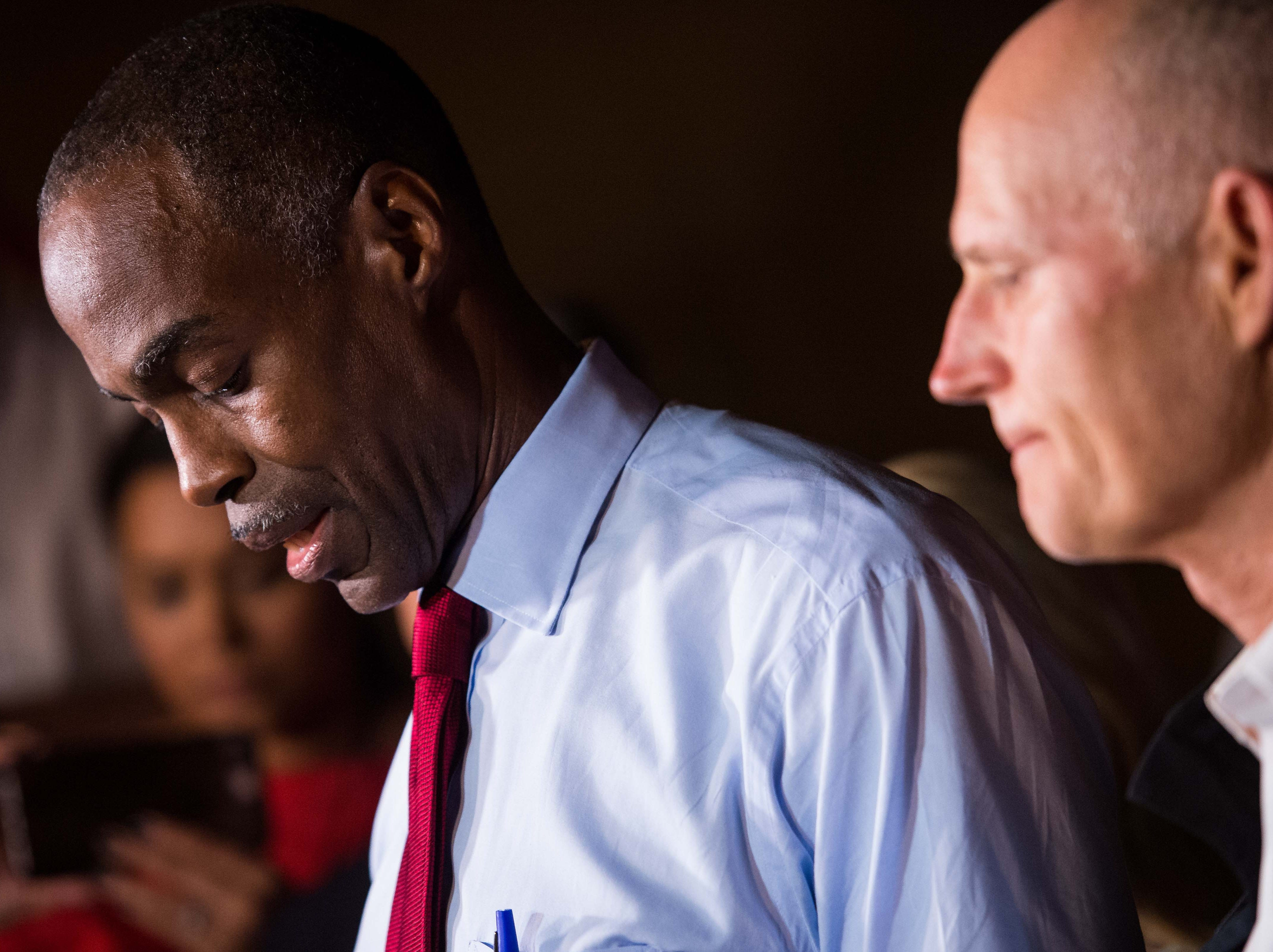 Broward County School Superintendent Robert Runcie speaks at a news conference, followed by Gov. Rick Scott (right), near Marjory Stoneman Douglas High School in Parkland on Wednesday, Feb. 14, 2018.