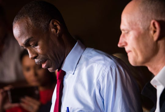 Broward County School Superintendent Robert Runcie speaks at a news conference, followed by Gov. Rick Scott, right, near Marjory Stoneman Douglas High School in Parkland, Fla., on Feb. 14, 2018.