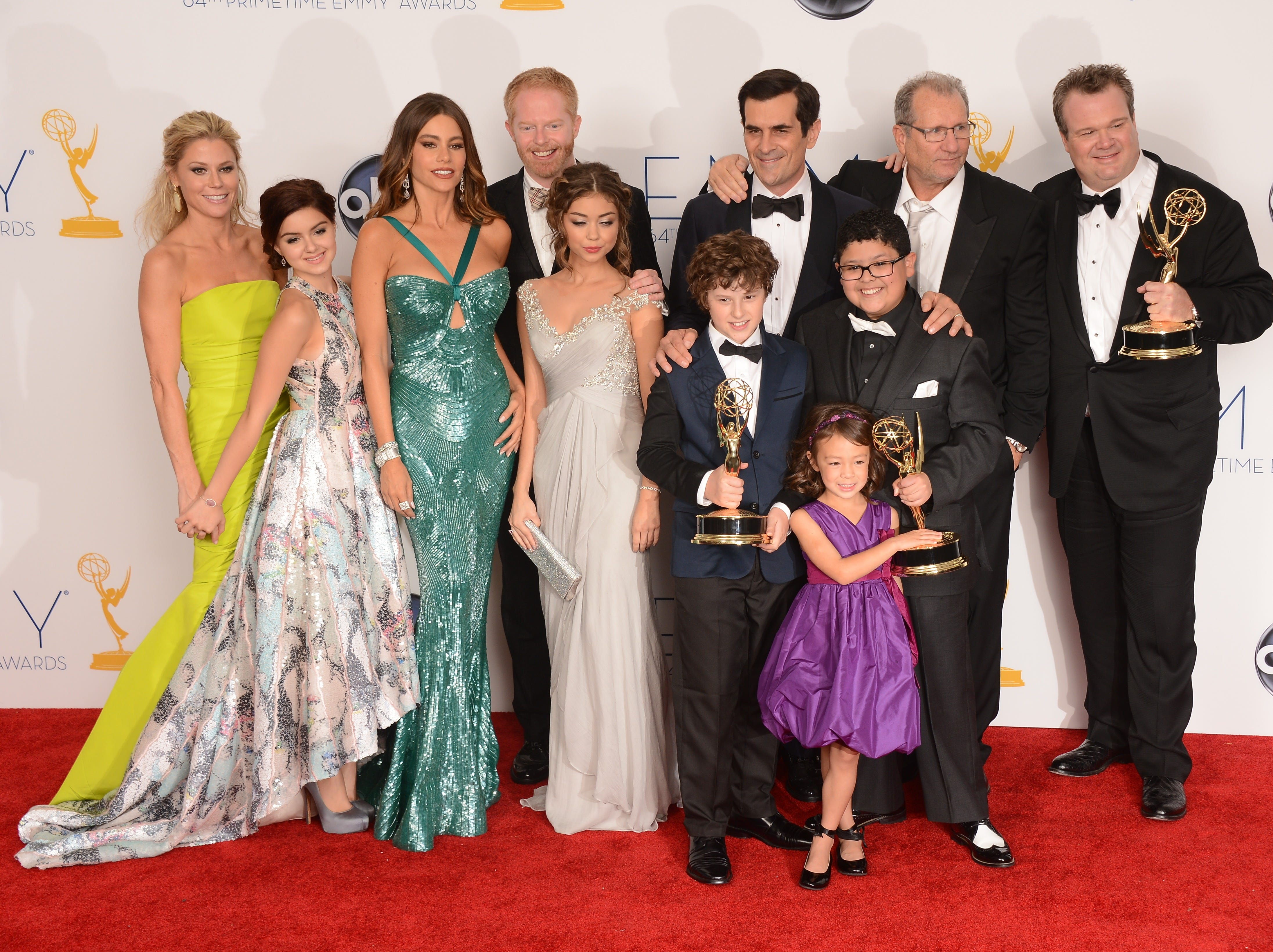 """""""Modern Family"""" has won 21 Emmy Awards, including best comedy for five years in a row from 2010-14. The full cast is seen here after their win in 2012."""