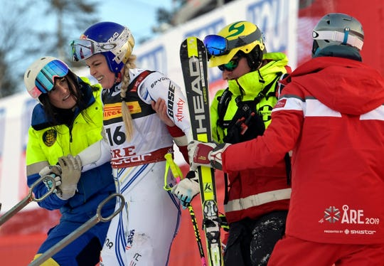 Lindsey Vonn is assisted after crashing during the women's super G at the alpine ski World Championships, in Are, Sweden.