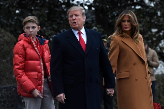 President Donald Trump,  first lady Melania Trump, and their son Barron leave the White House and head to Mar-a-Lago to spend Super Bowl Weekend in Florida, on Feb. 1, 2019.
