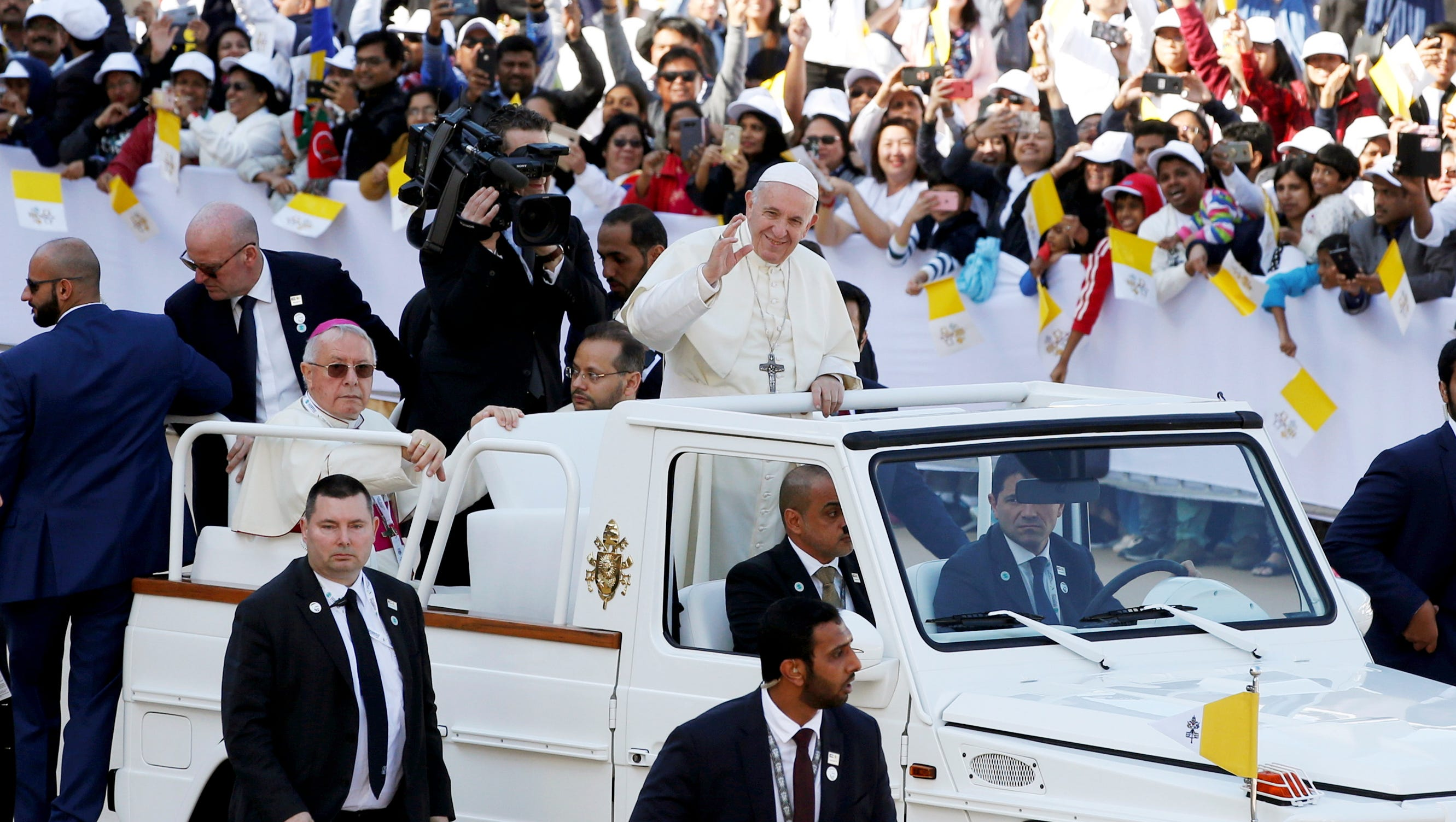 Pope Francis (center) arrives to lead a papal mass at Zayed Sports City in Abu Dhabi, United Arab Emirates.