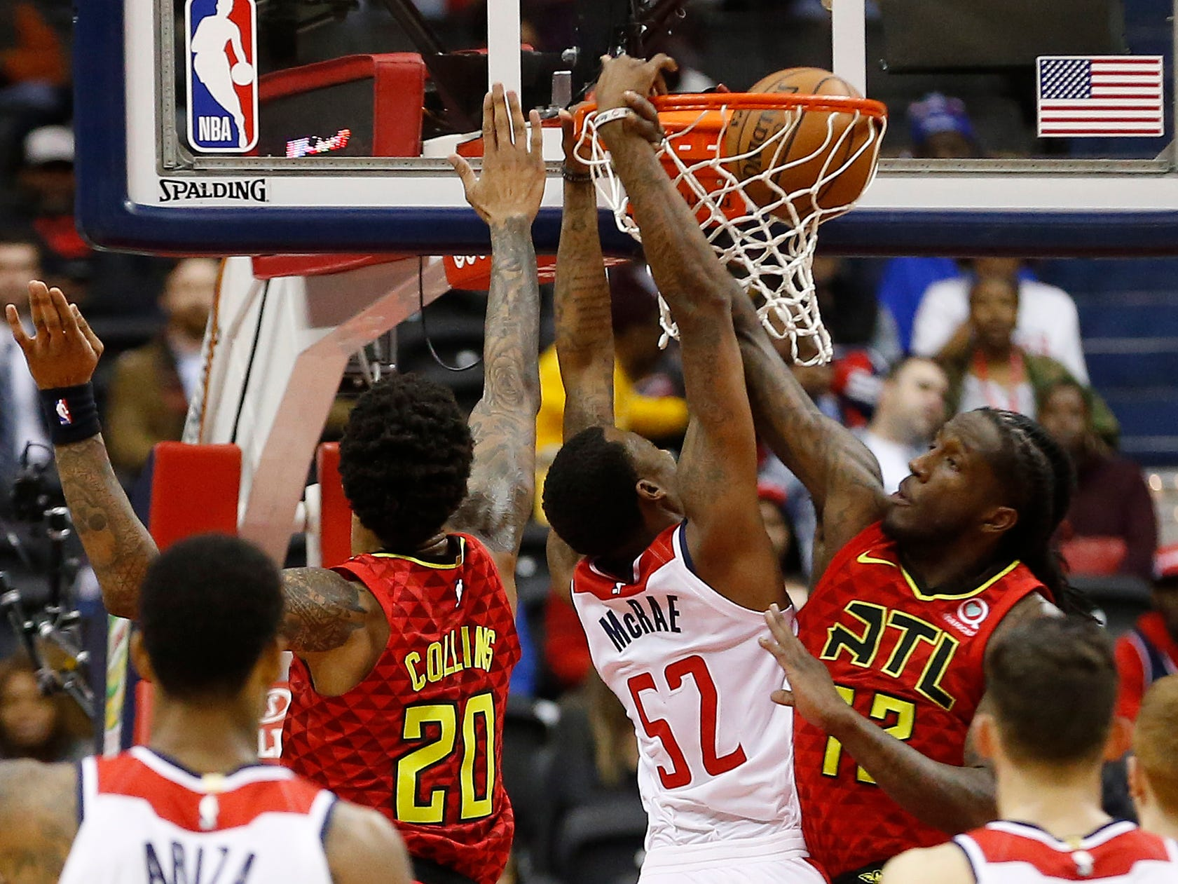 Feb. 4: Washington Wizards guard Jordan McRae (52) dunks the ball as Atlanta Hawks forward Taurean Prince (12) and Hawks forward John Collins (20) defend in the second quarter at Capital One Arena.