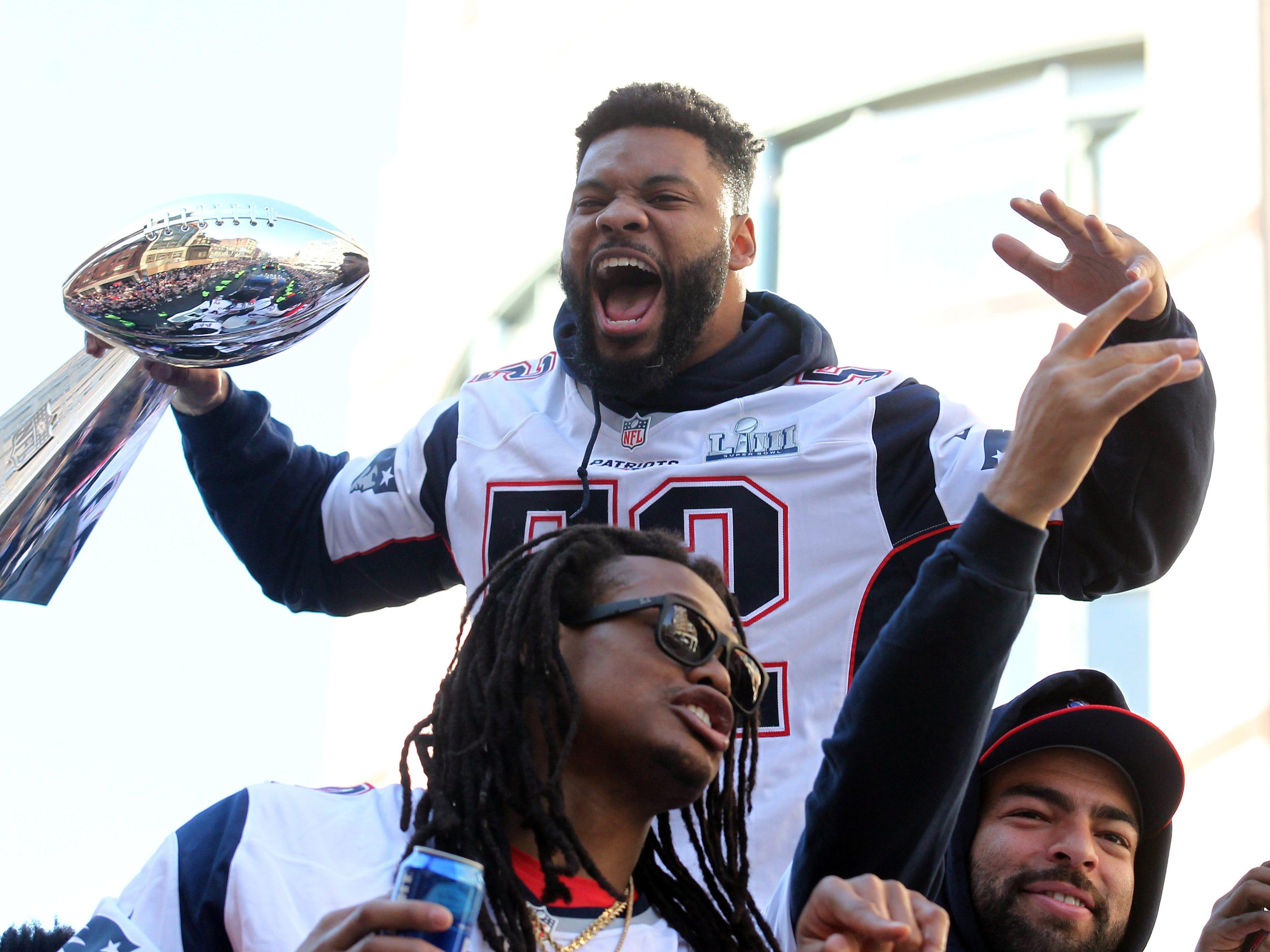 New England Patriots linebacker Elandon Roberts (52) yells at fans during the Super Bowl LIII championship parade.