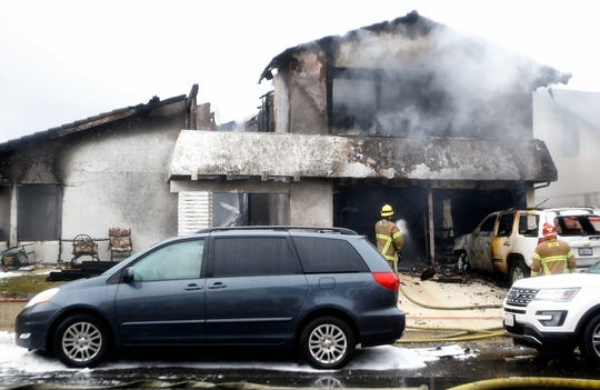 Firefighters work the scene of a deadly plane crash in the residential neighborhood of Yorba Linda, Calif., on Sunday.