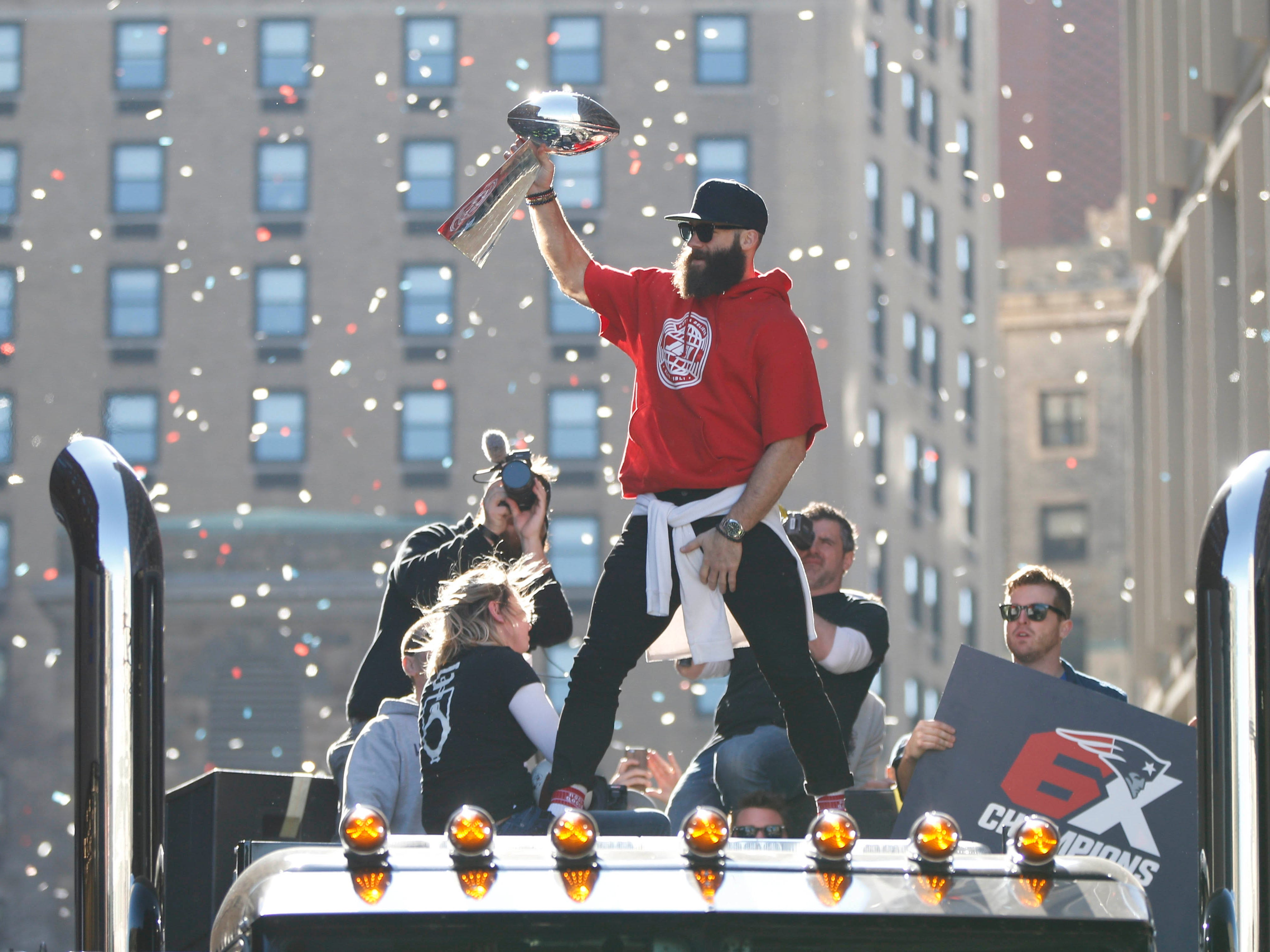 New England Patriots wide receiver Julian Edelman (11) celebrates with the Vince Lombardi Trophy during the Super Bowl LIII championship parade through downtown Boston.