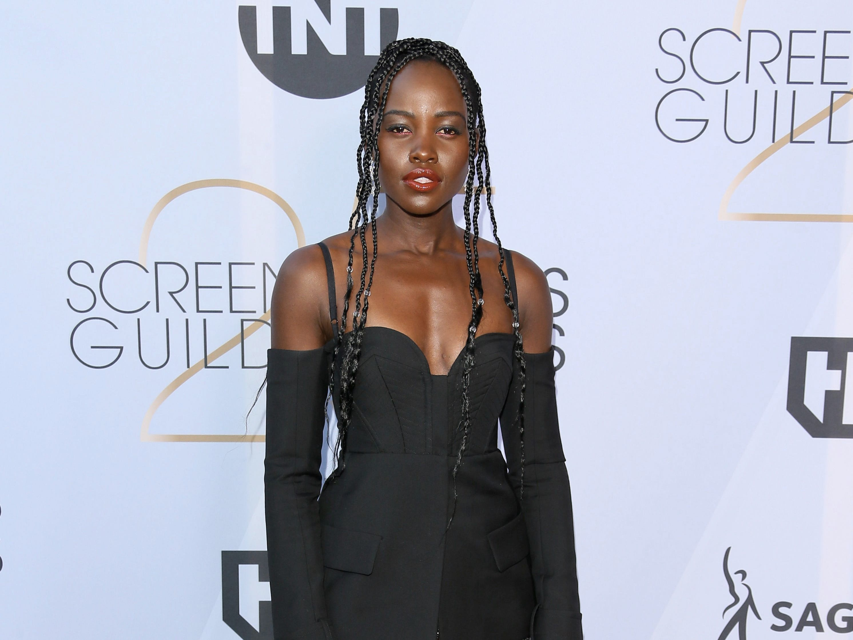 Actress Lupita Nyong'o arrives for the 25th Annual Screen Actors Guild Awards at the Shrine Auditorium in Los Angeles on January 27, 2019. (Photo by Jean-Baptiste LACROIX / AFP)JEAN-BAPTISTE LACROIX/AFP/Getty Images ORG XMIT: 25th Annu ORIG FILE ID: AFP_1CQ8UN